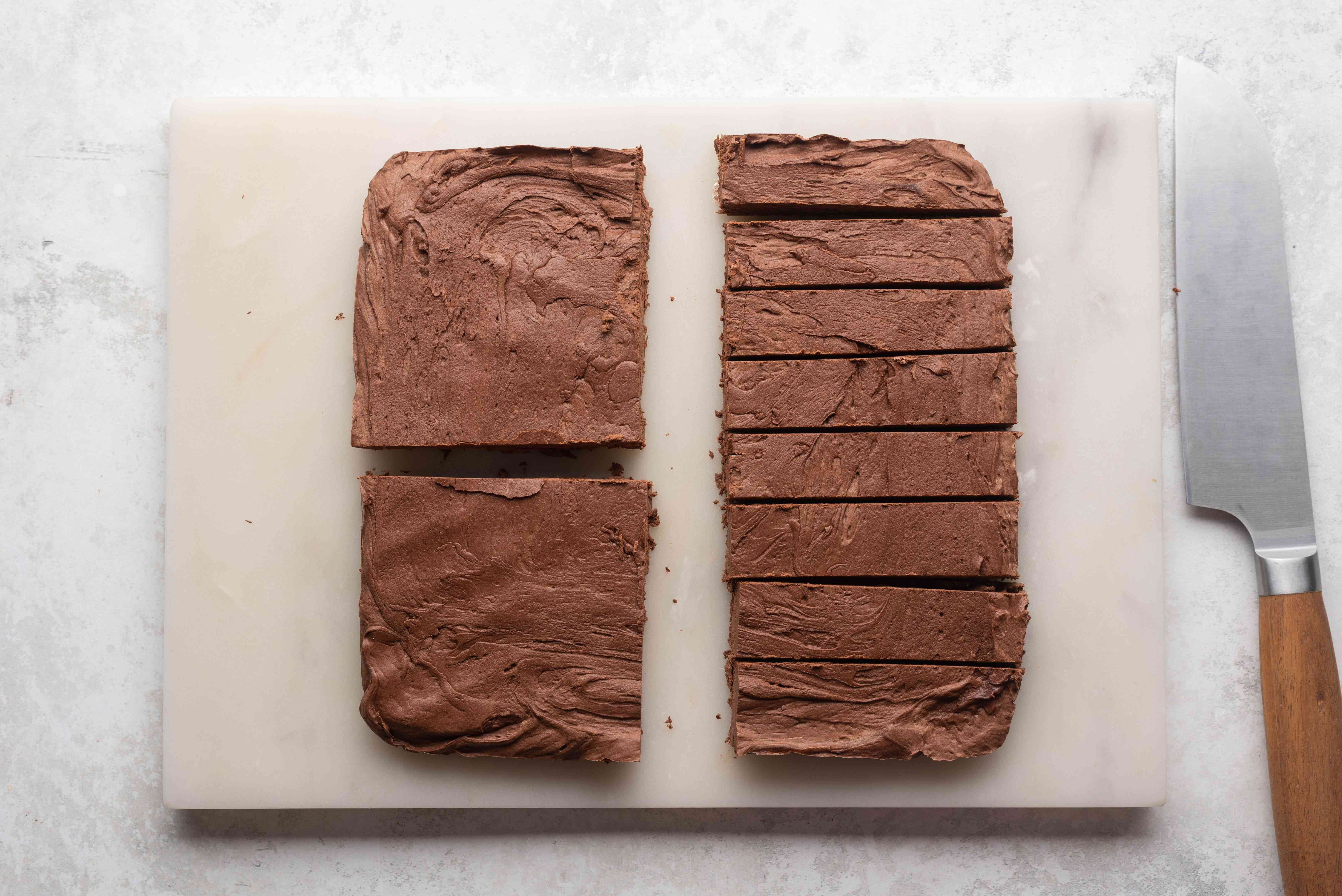 fudge removed from the baking pan and cut into pieces