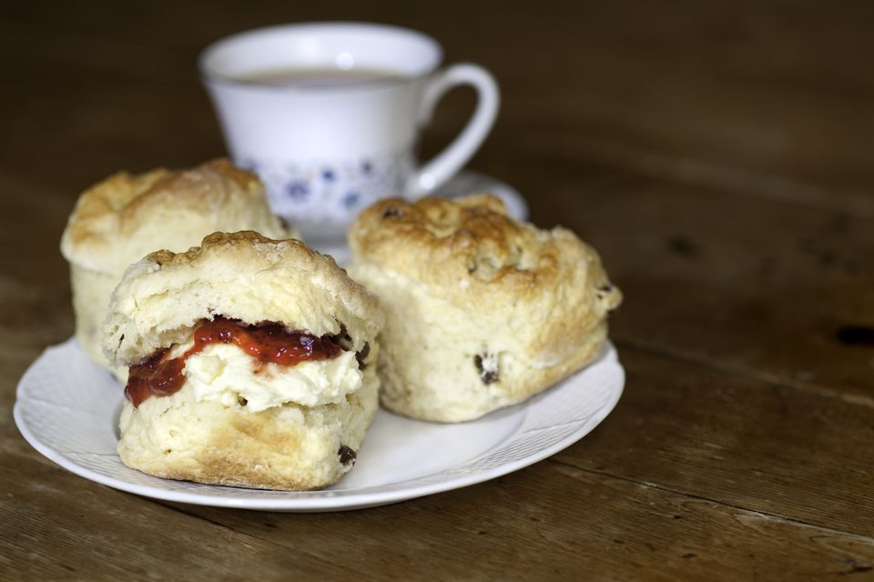 Close up of cream tea on a white dish