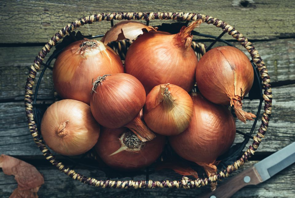 High Angle View Of Onions In Basket On Table