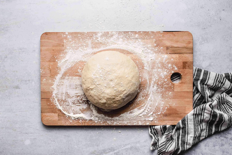 Ball of dough on cutting board