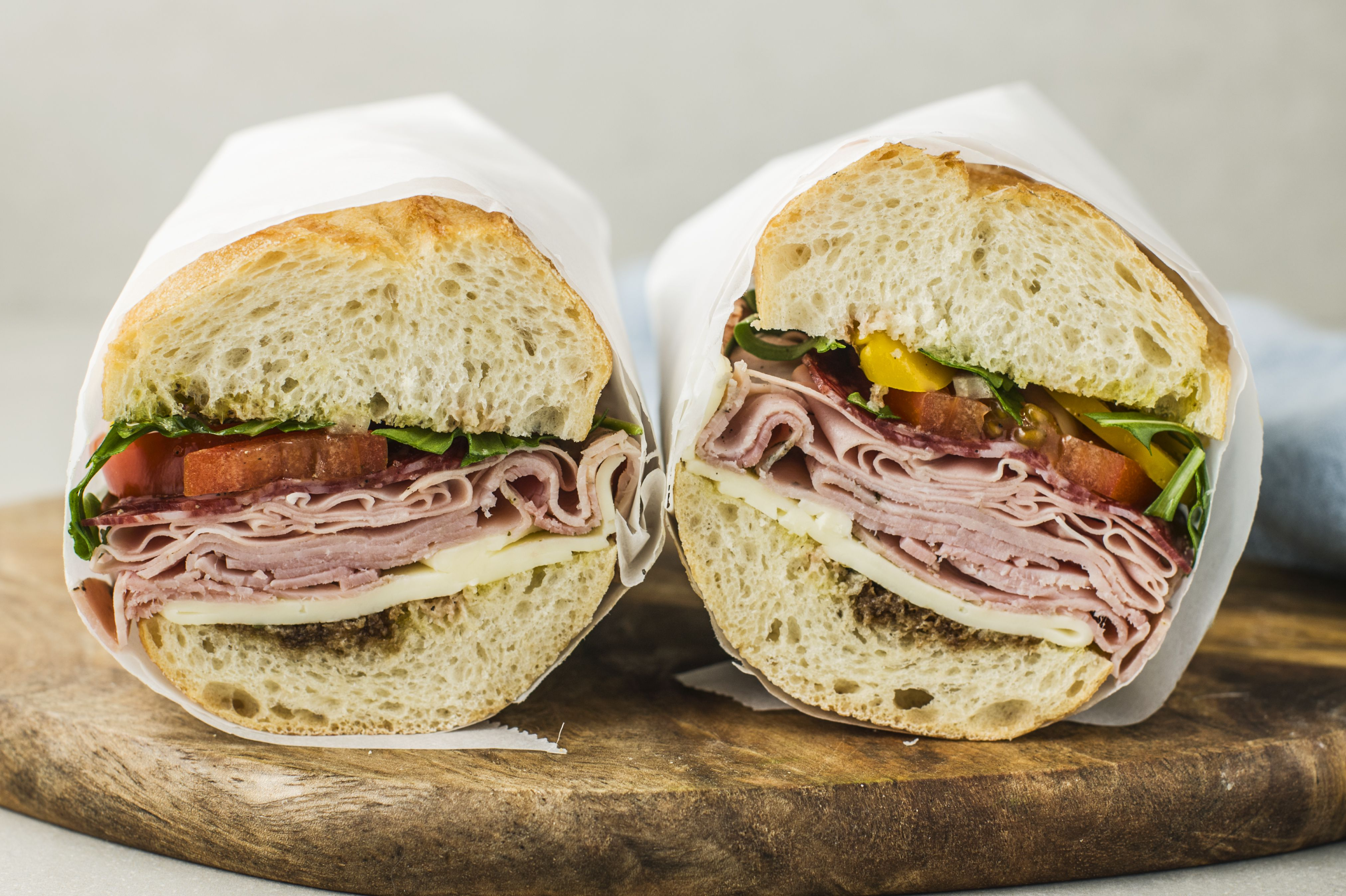 Wrap the sandwich in butcher paper and cut