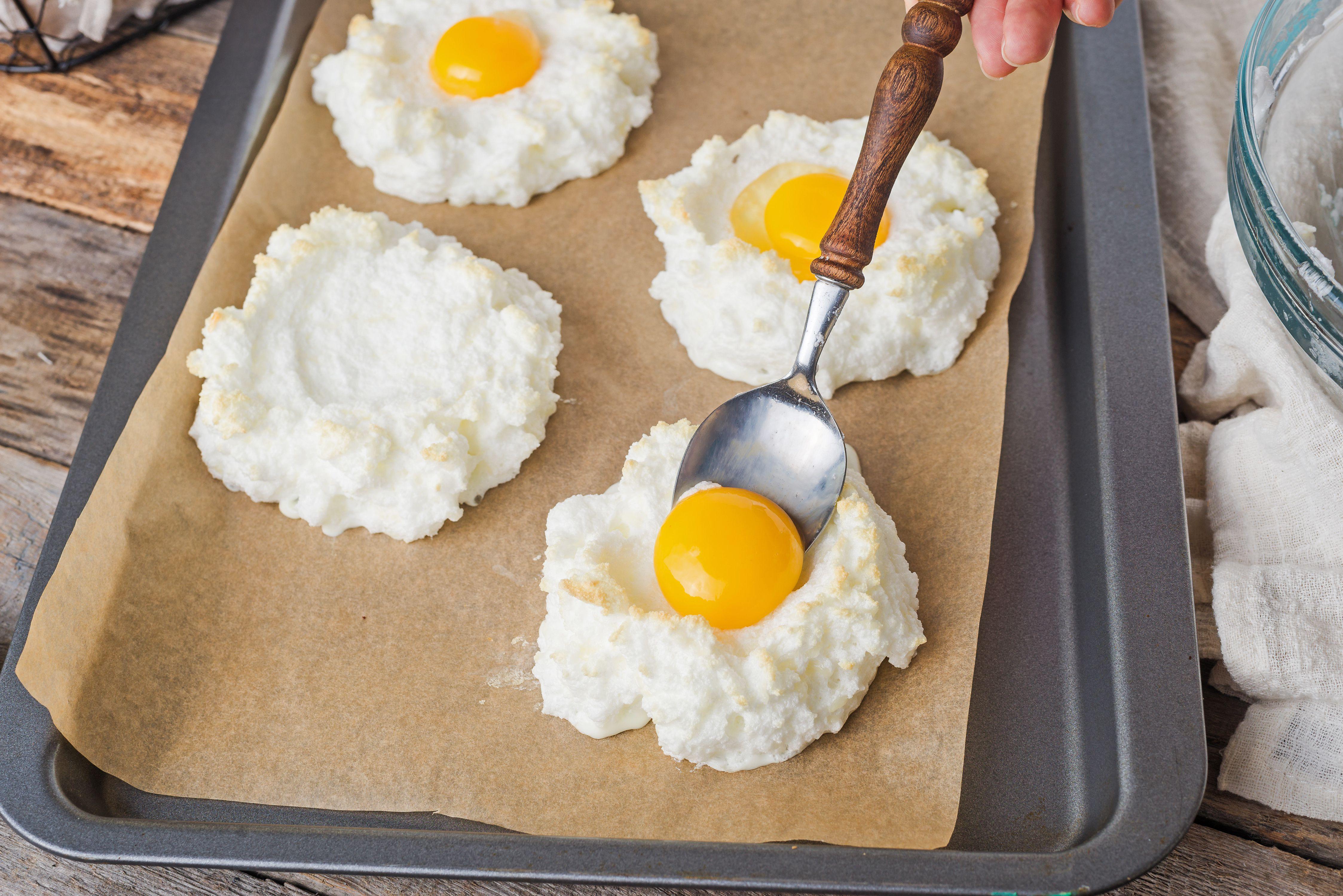 Spoon yolk into center