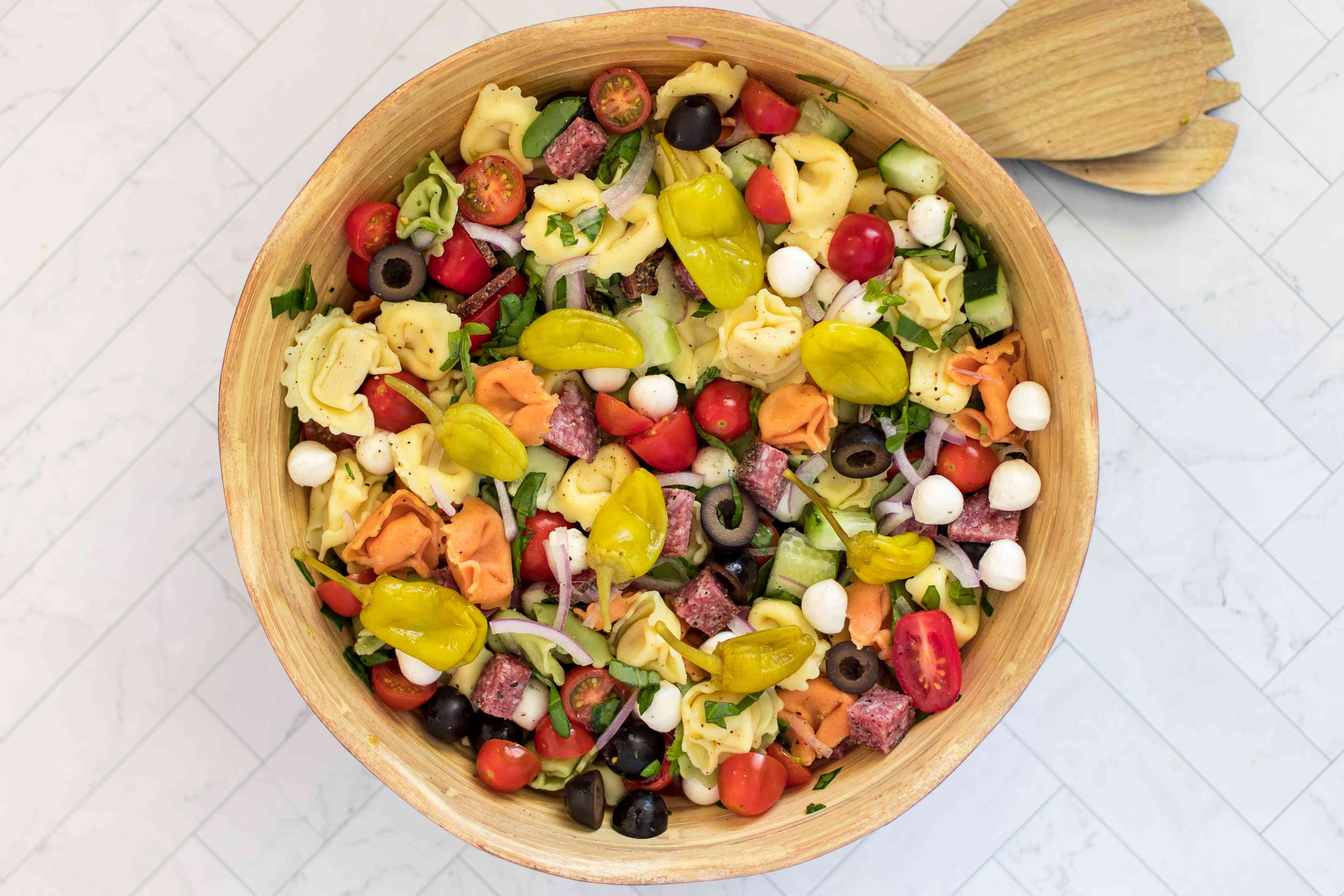 tortellini pasta salad with vegetables, cheese, and salami