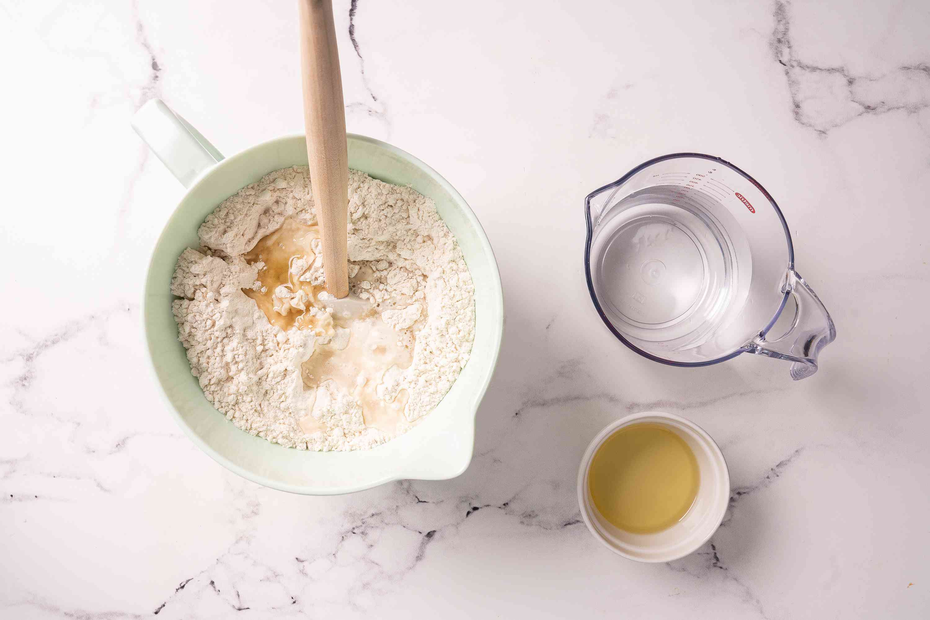 Flour and liquid ingredients mixed in a bowl