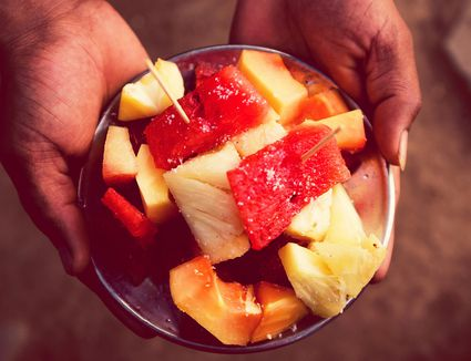 Cropped Hands Holding Fruit Salad In Bowl