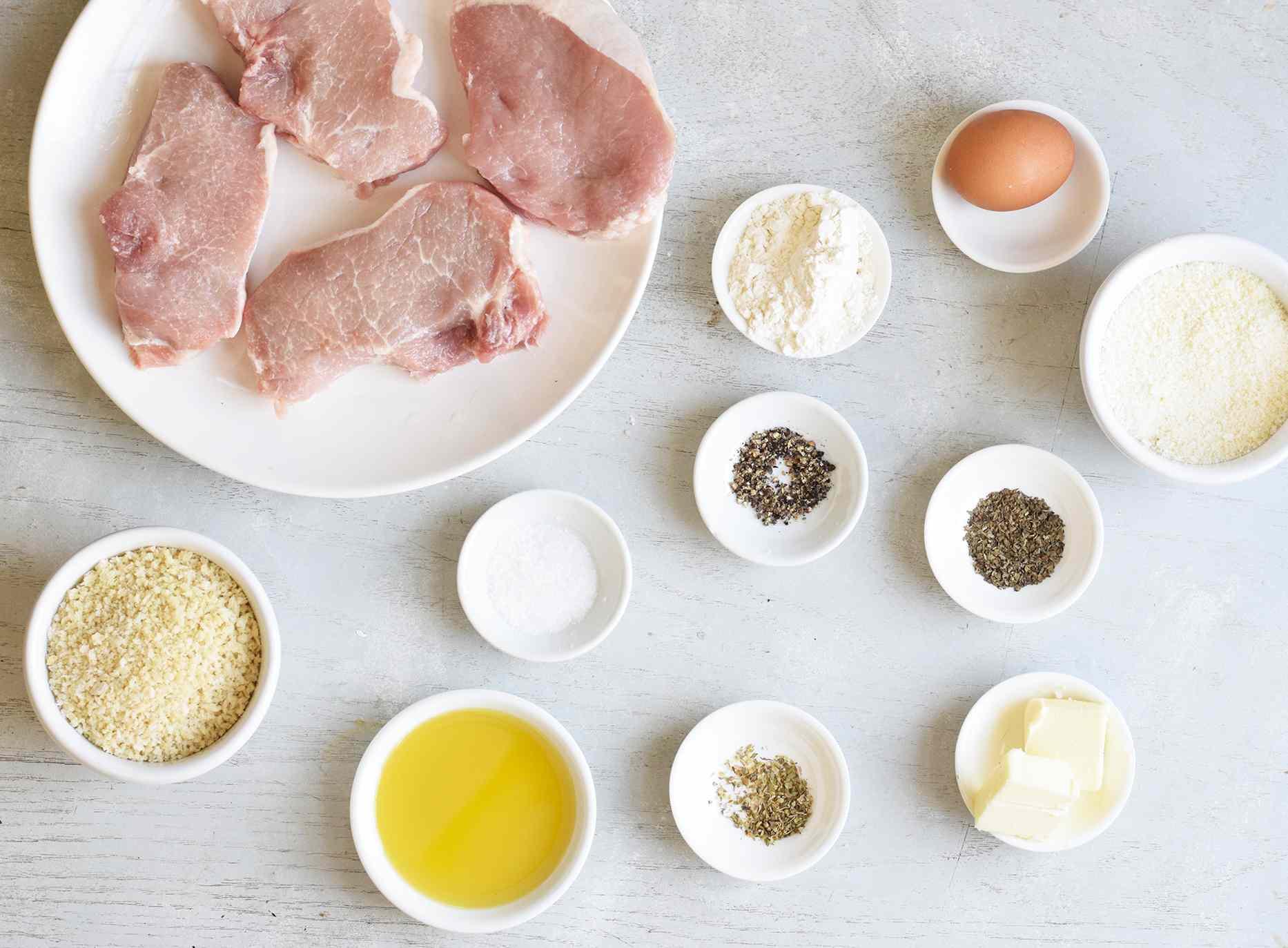 ingredients for parmesan pork chops on a platter