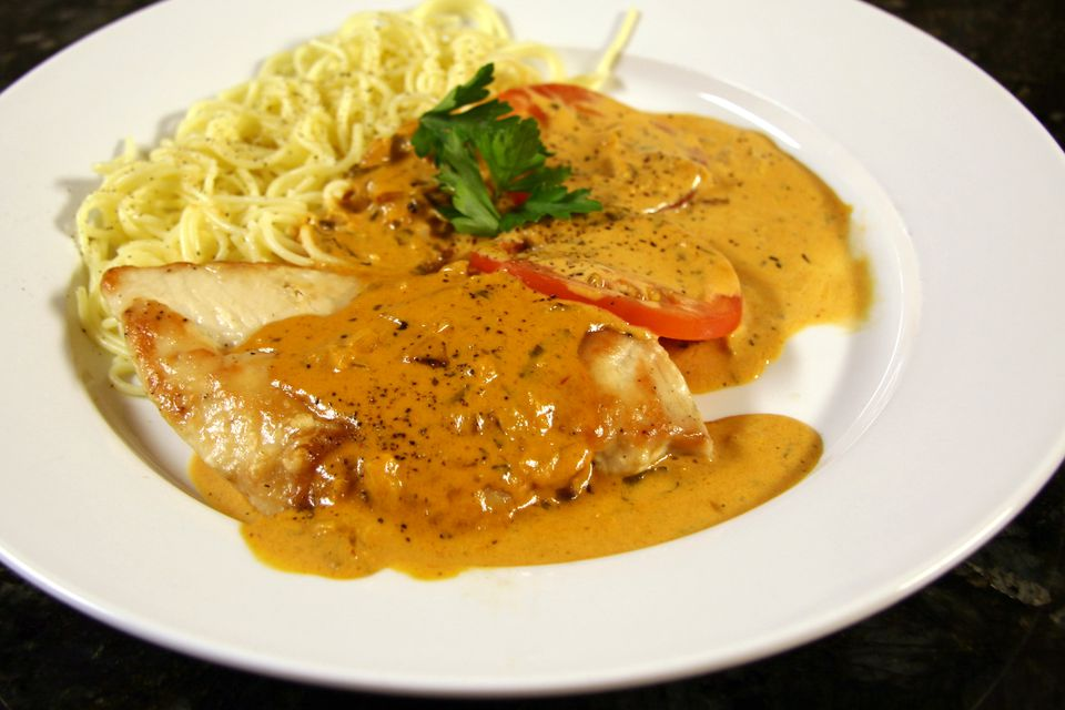 Chicken breasts with tomato cream sauce