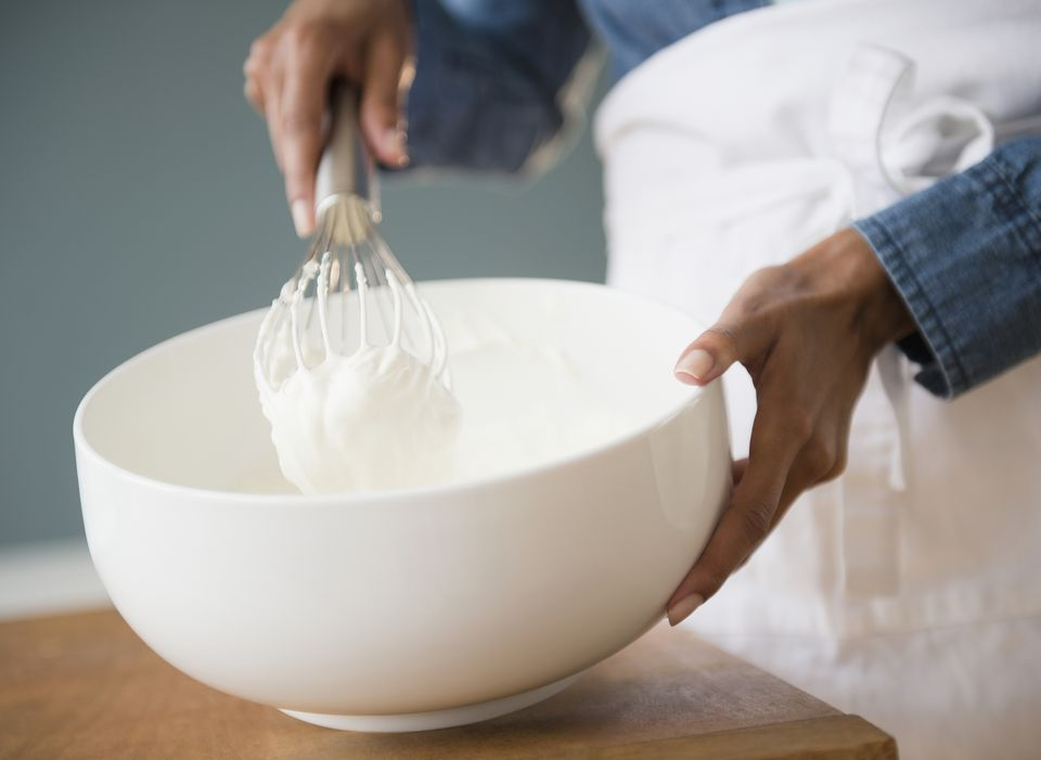 Cape Verdean woman whisking cream