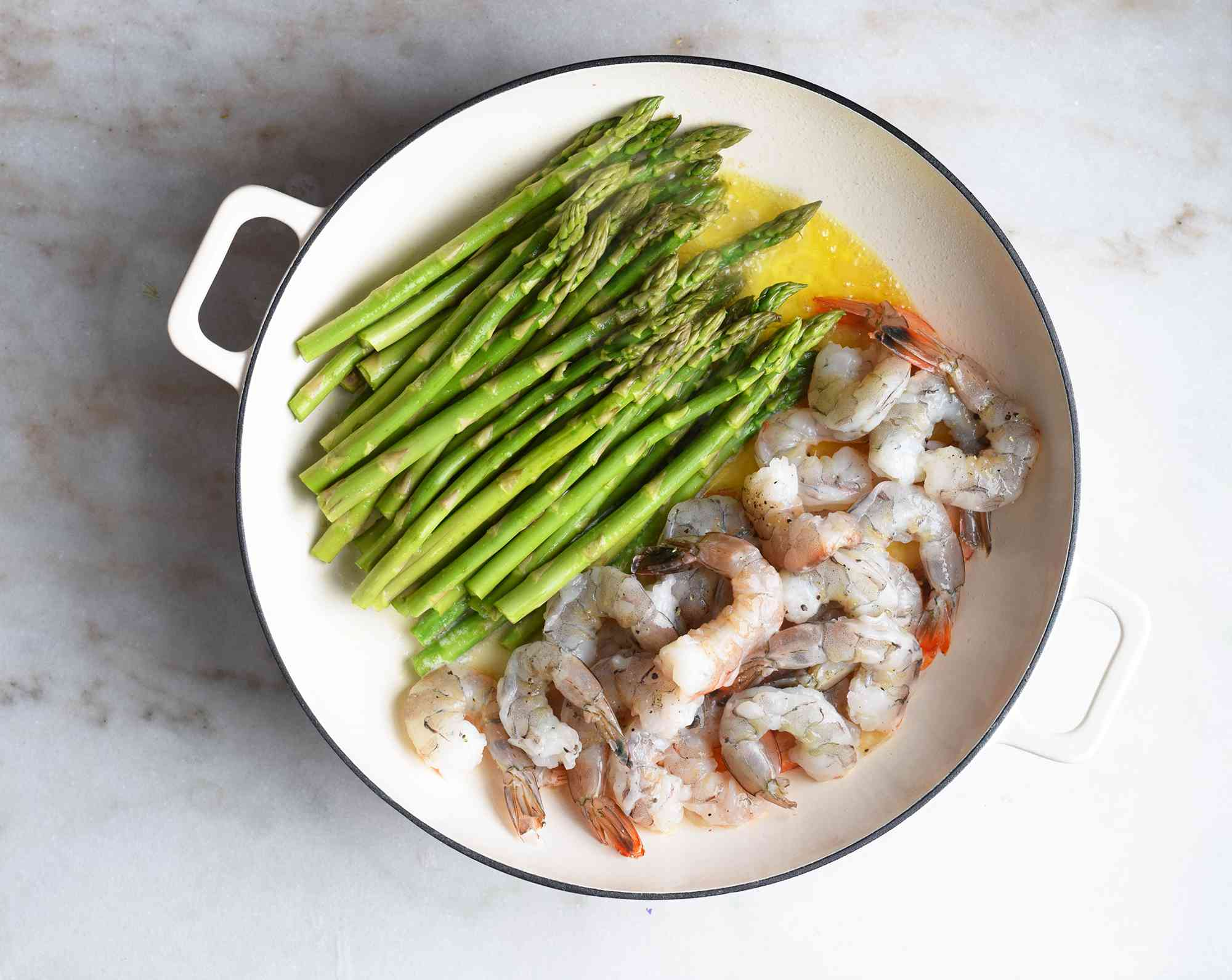 shrimp and asparagus added to one large pan