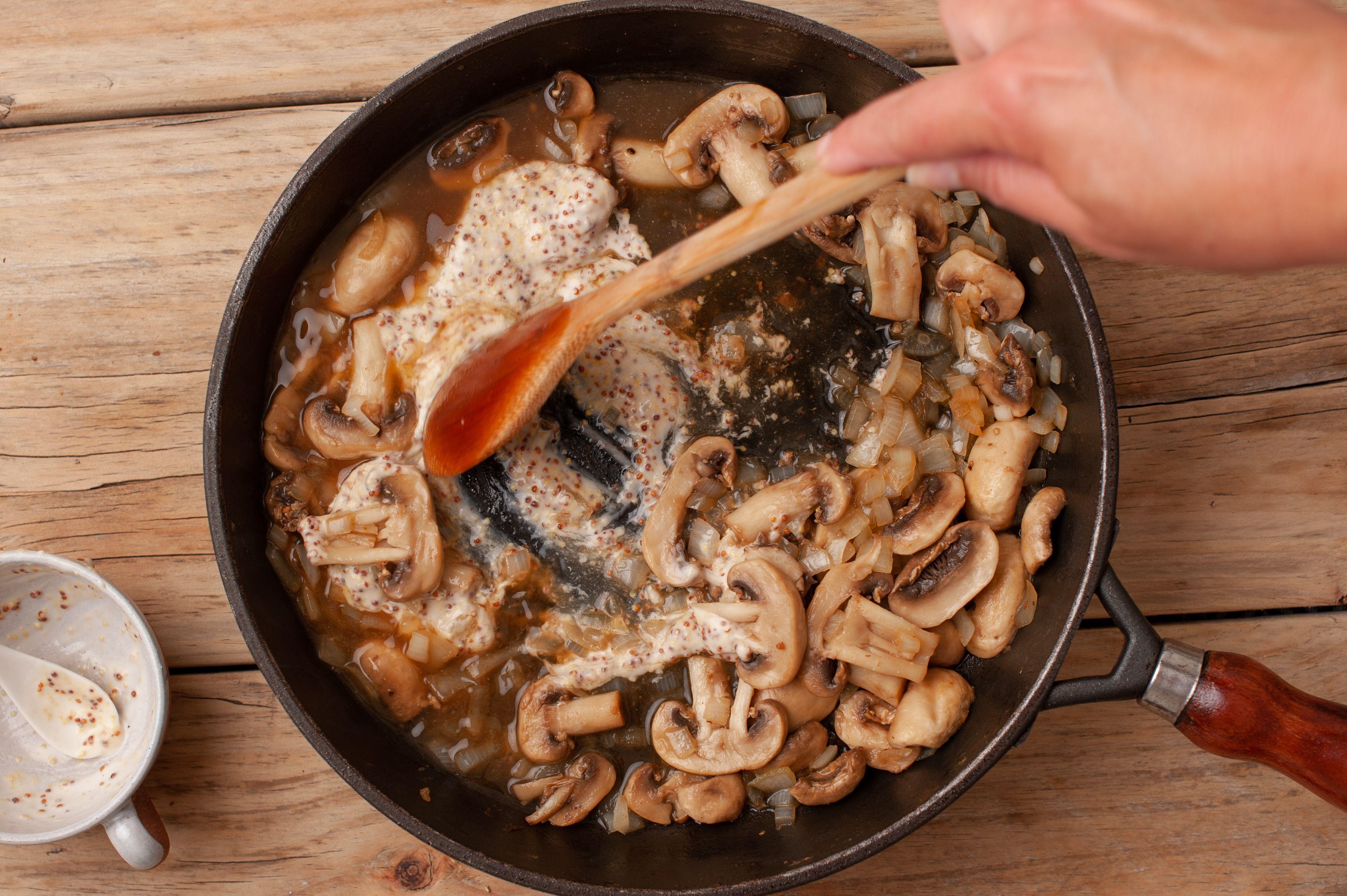 Stir broth into skillet