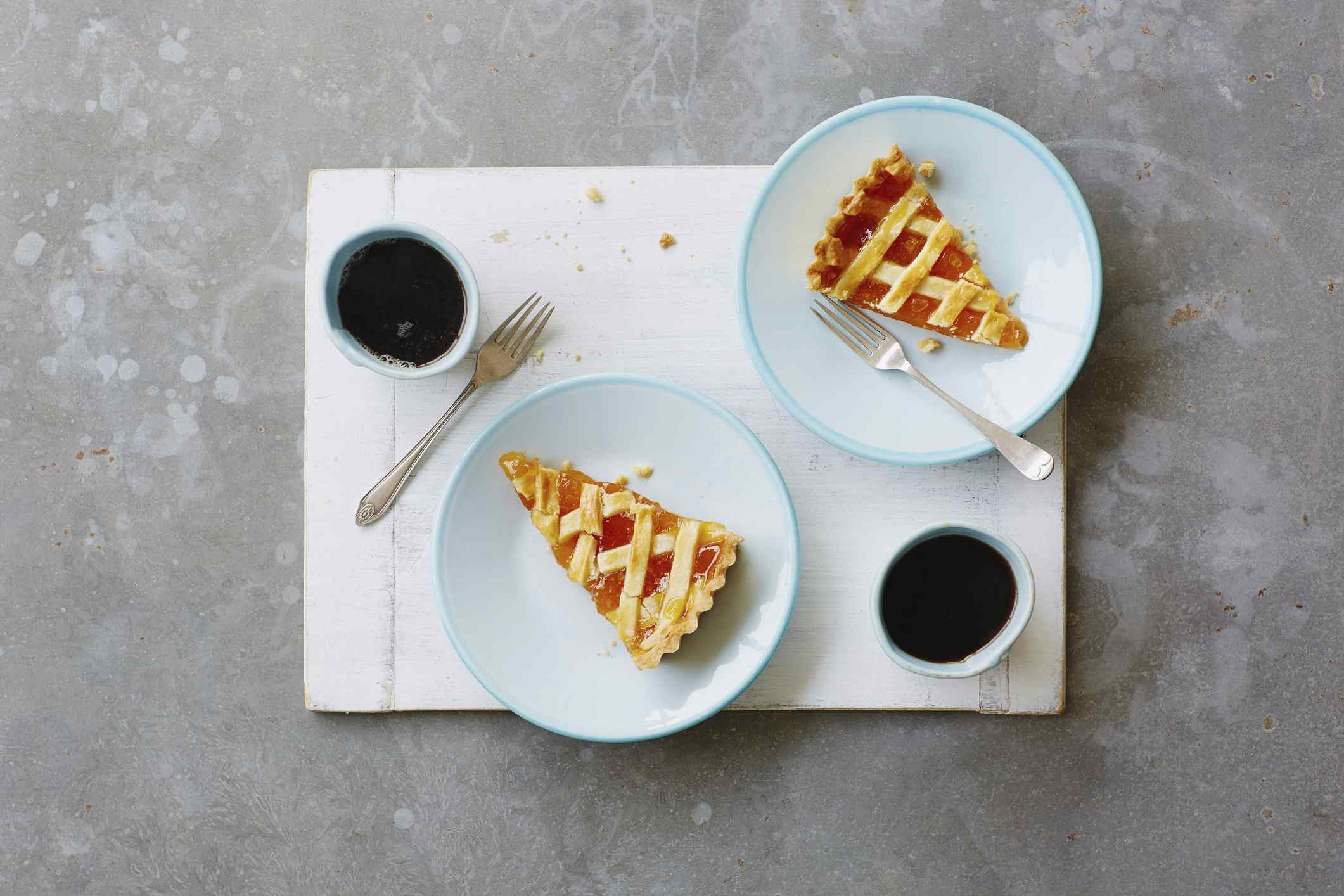 High angle view of jam tart on wooden board