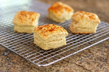 Beer biscuits on a rack on a table.