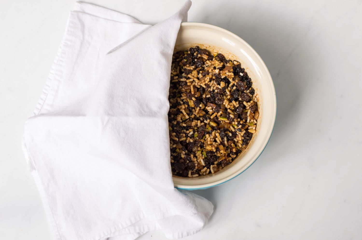 Mincemeat ingredients in a baking dish with a dish towel