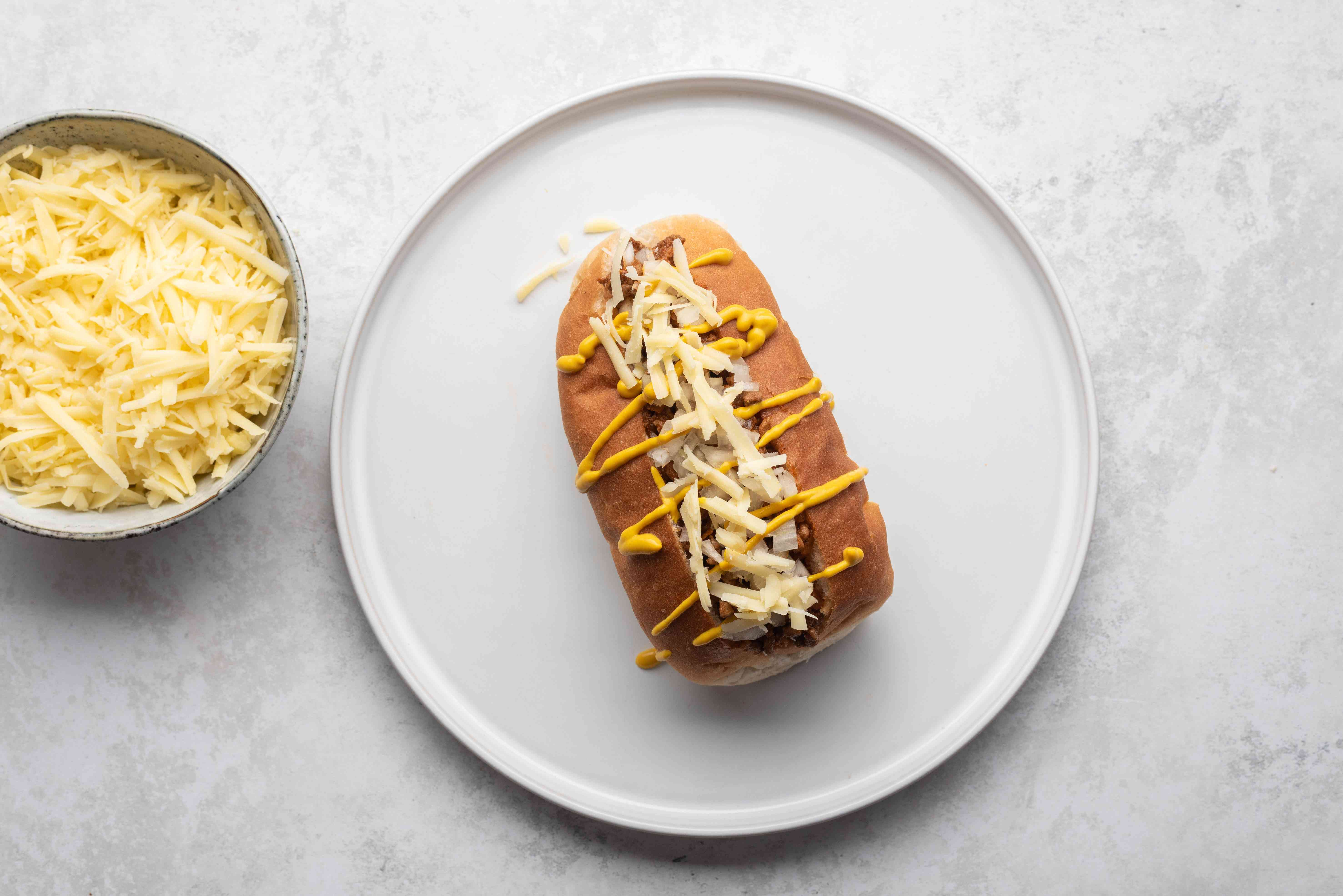 cheese on top of the mustard on the hot dog