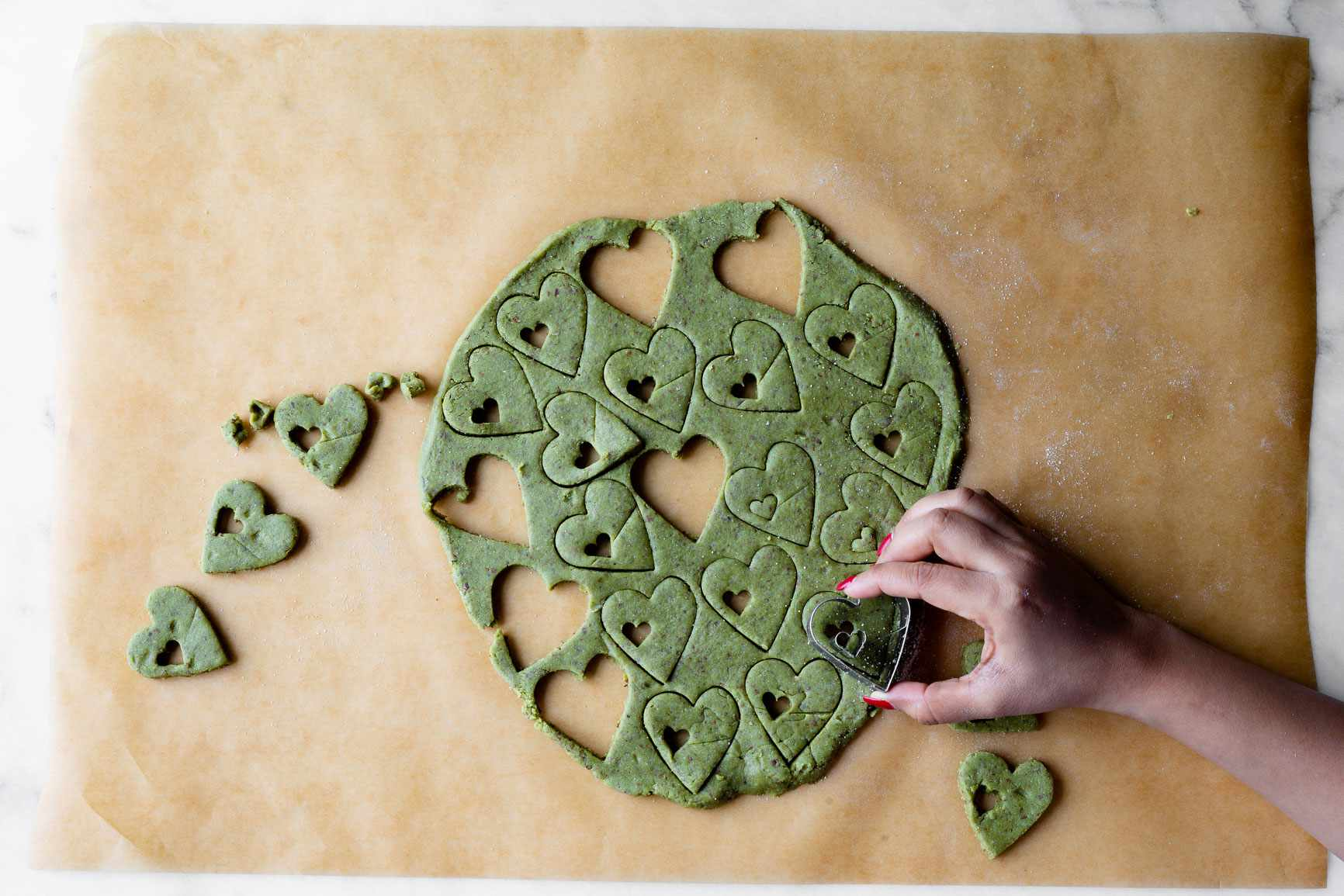 Cutting out cookies in green matcha dough
