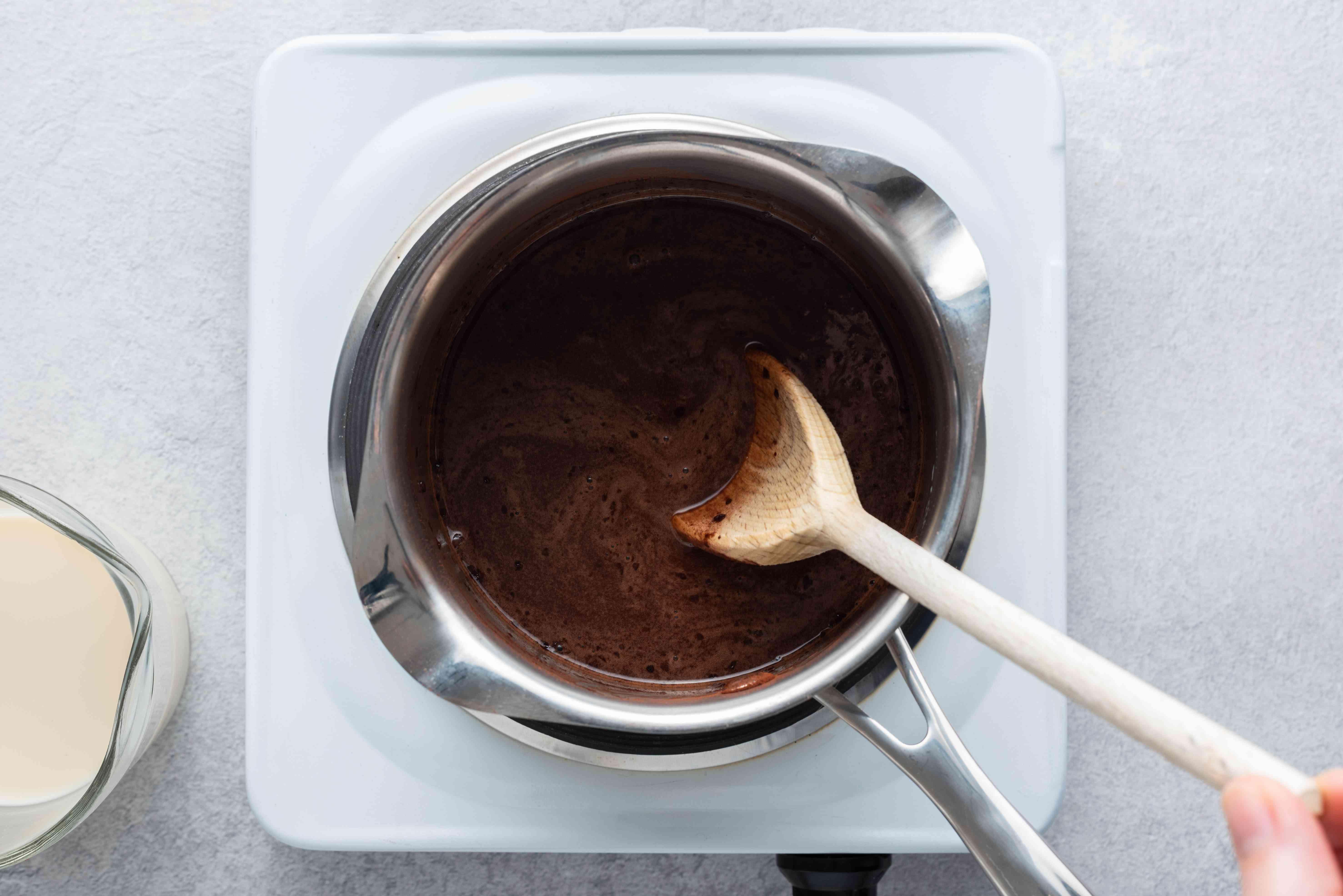 add almond milk to the cocoa powder mixture in the saucepan