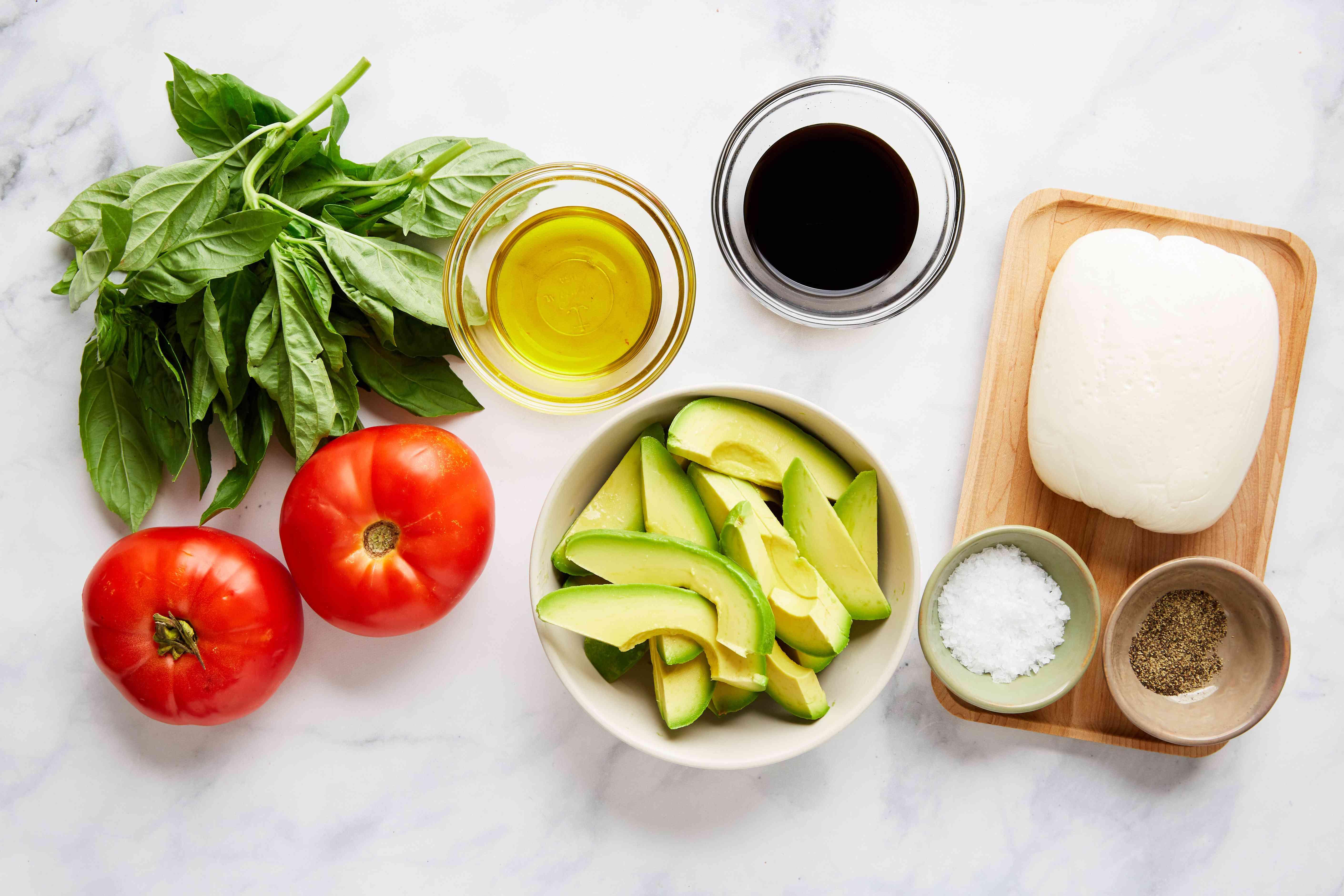 Ingredients for avocado tomato and mozzarella salad