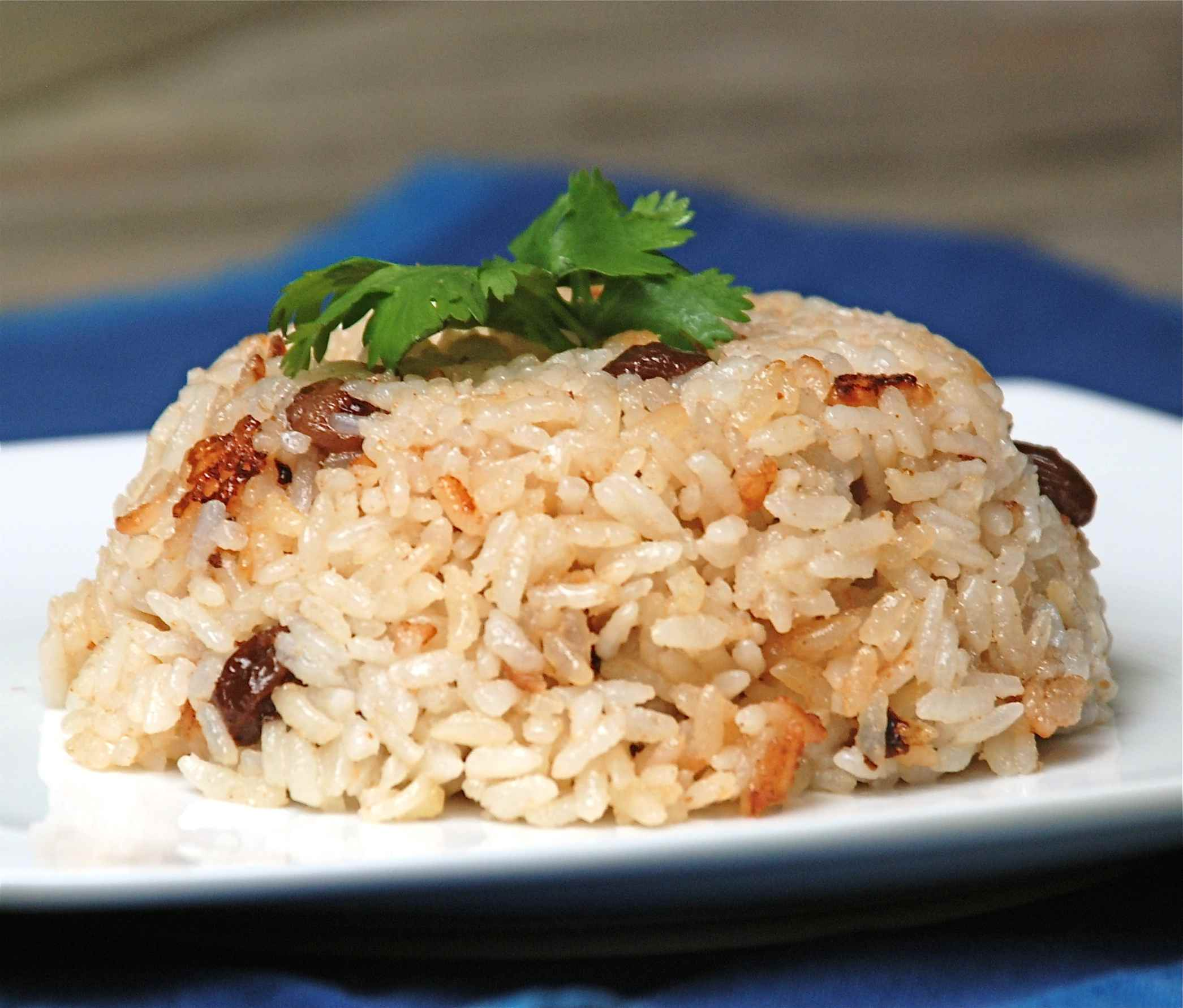 Arroz con coco (coconut rice) on a white plate