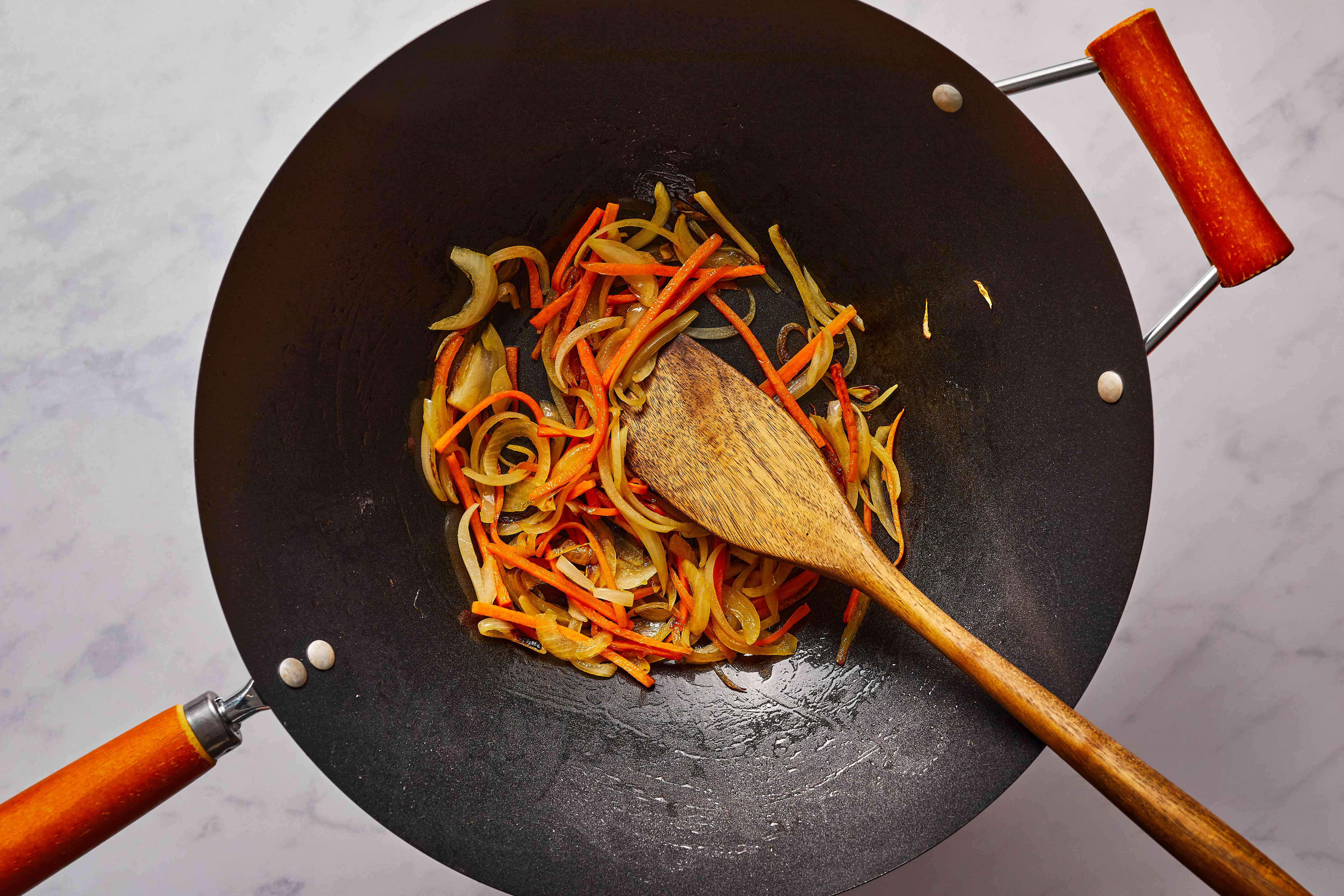 sweet onion and carrots in a pan