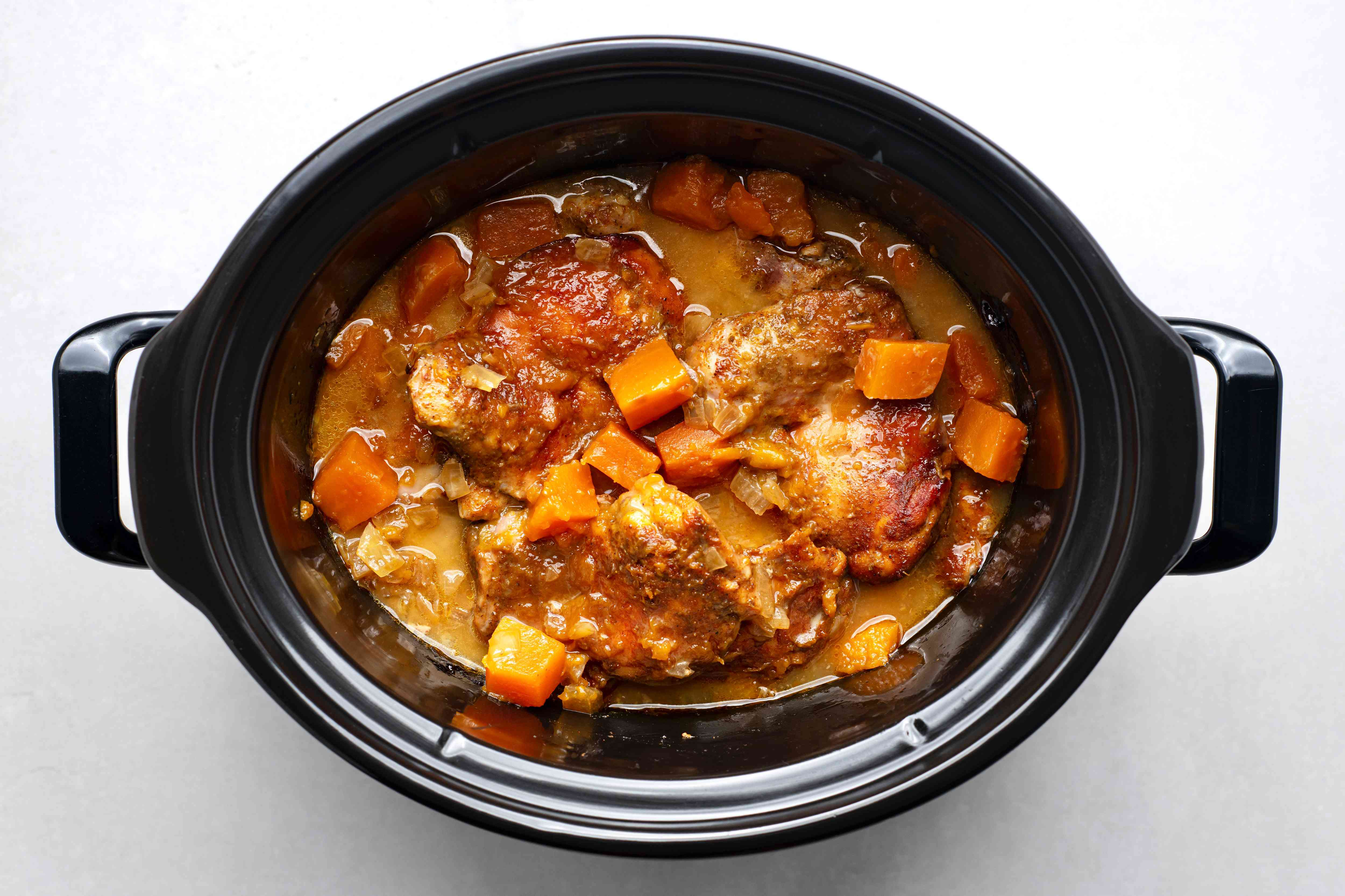chicken and vegetables cooking in a crockpot