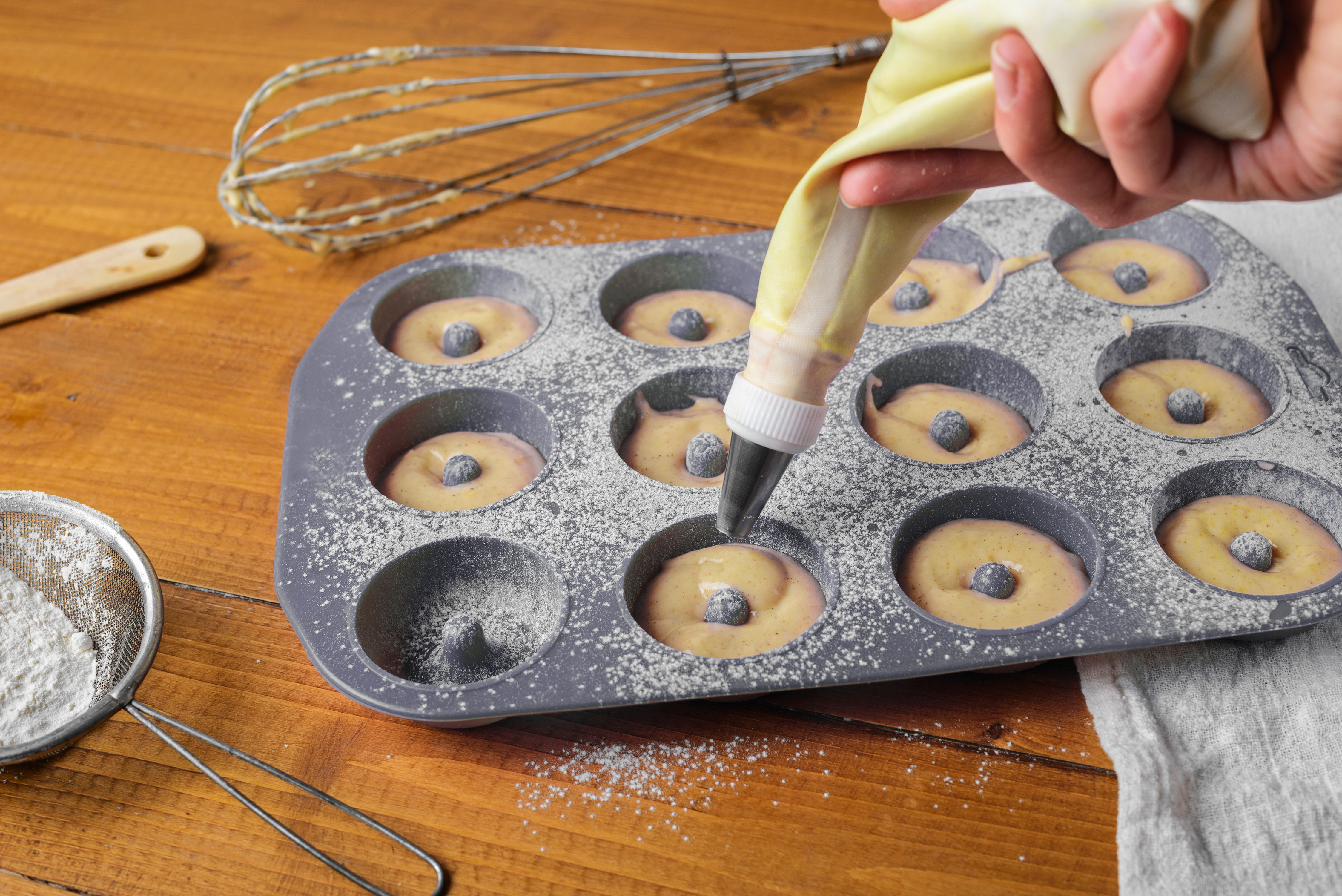 Spoon batter into donut pan
