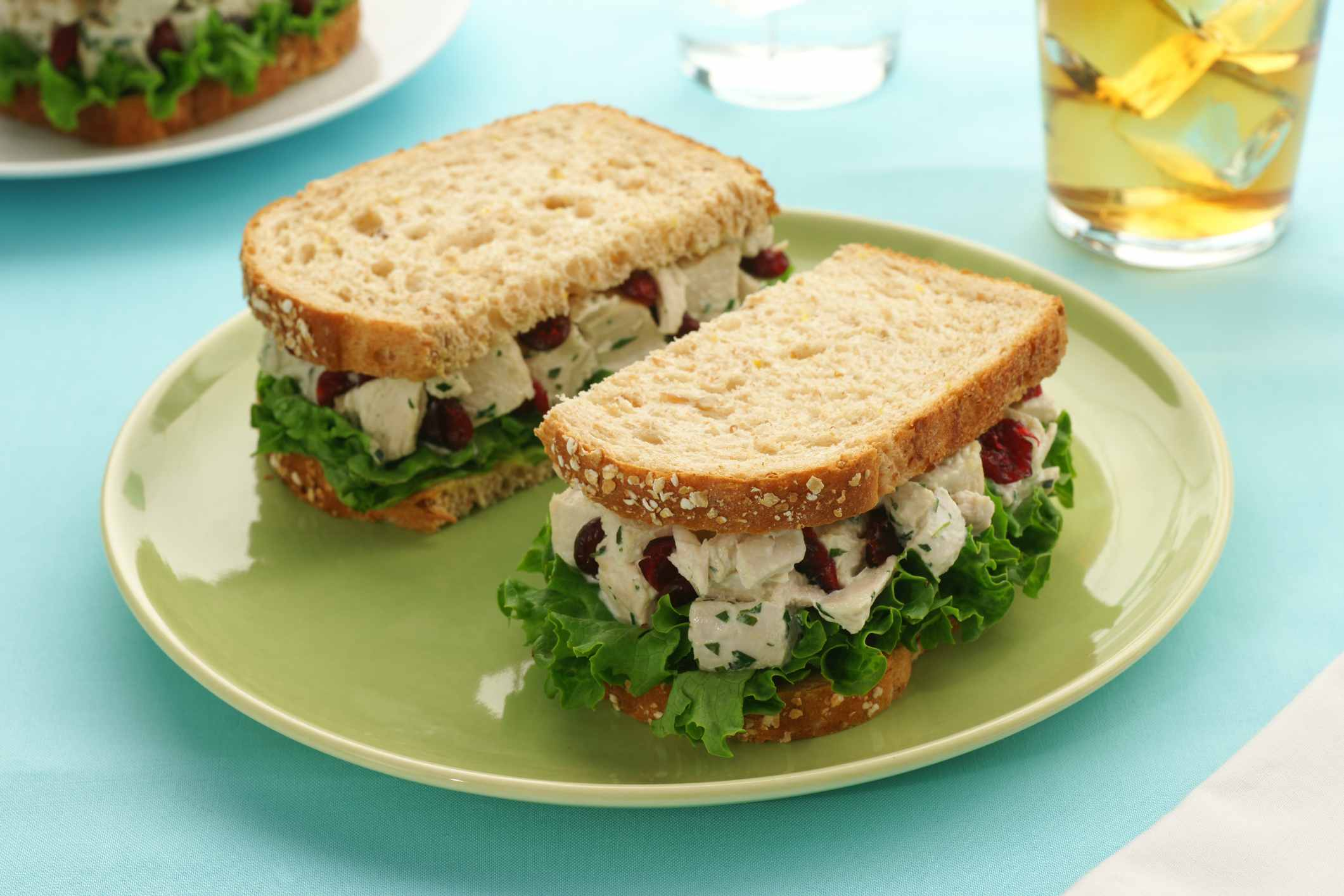 Chicken salad sandwich with cranberries and lettuce