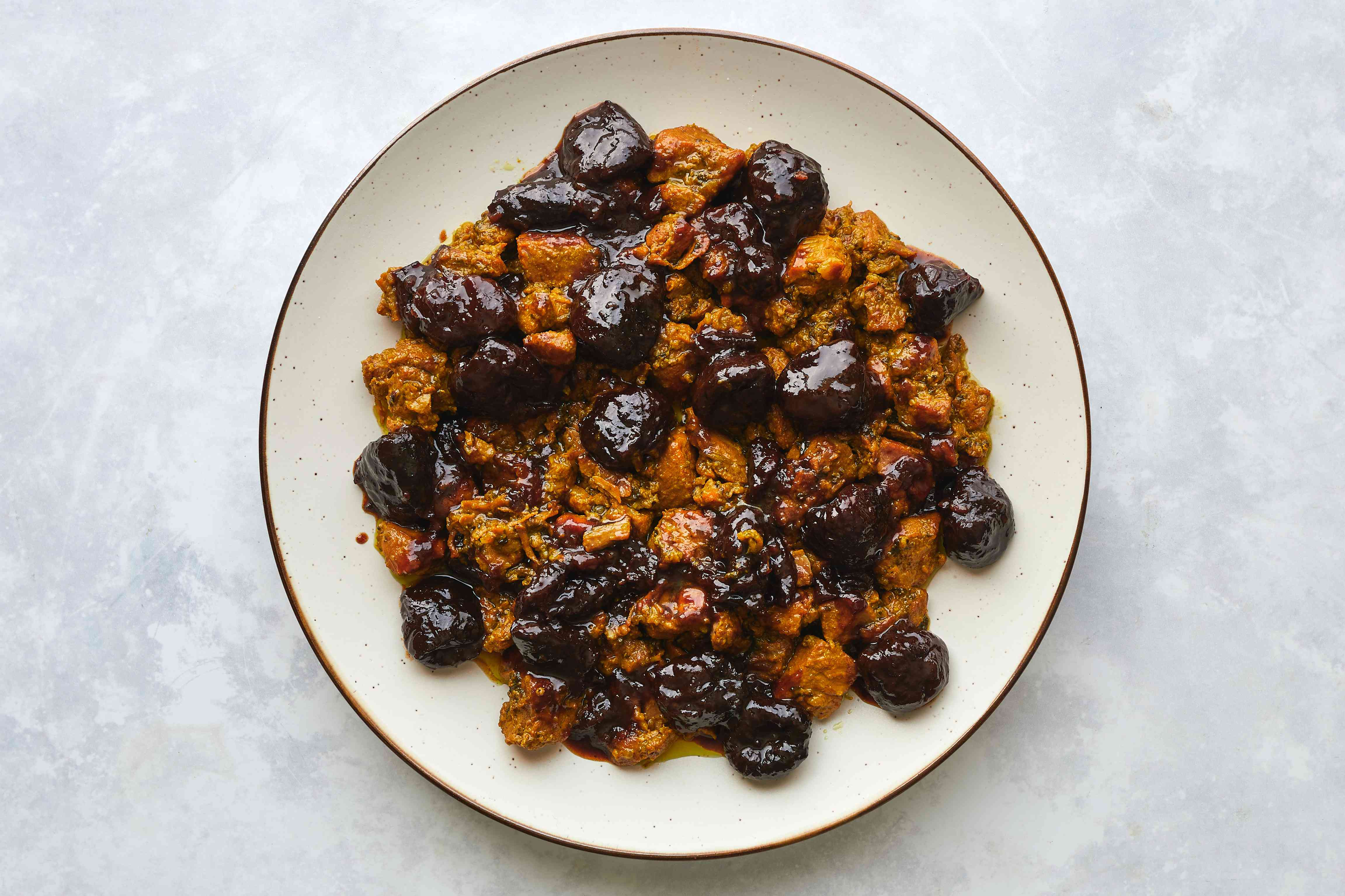 Pressure Cooker Moroccan Lamb or Beef Tagine With Prunes on a plate
