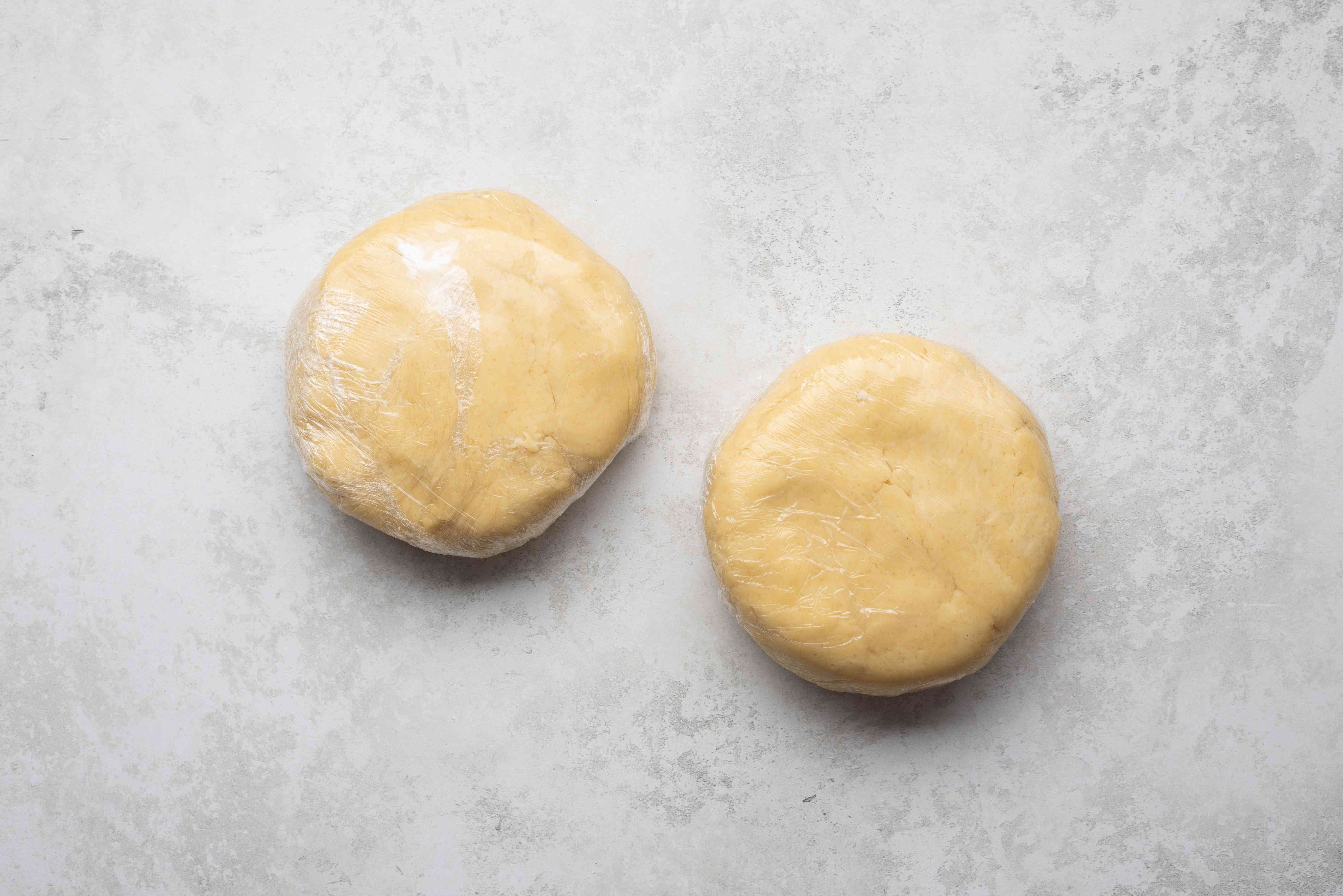 crust dough pieces wrapped in plastic wrap