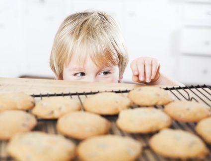 Little boy sneaking cookies
