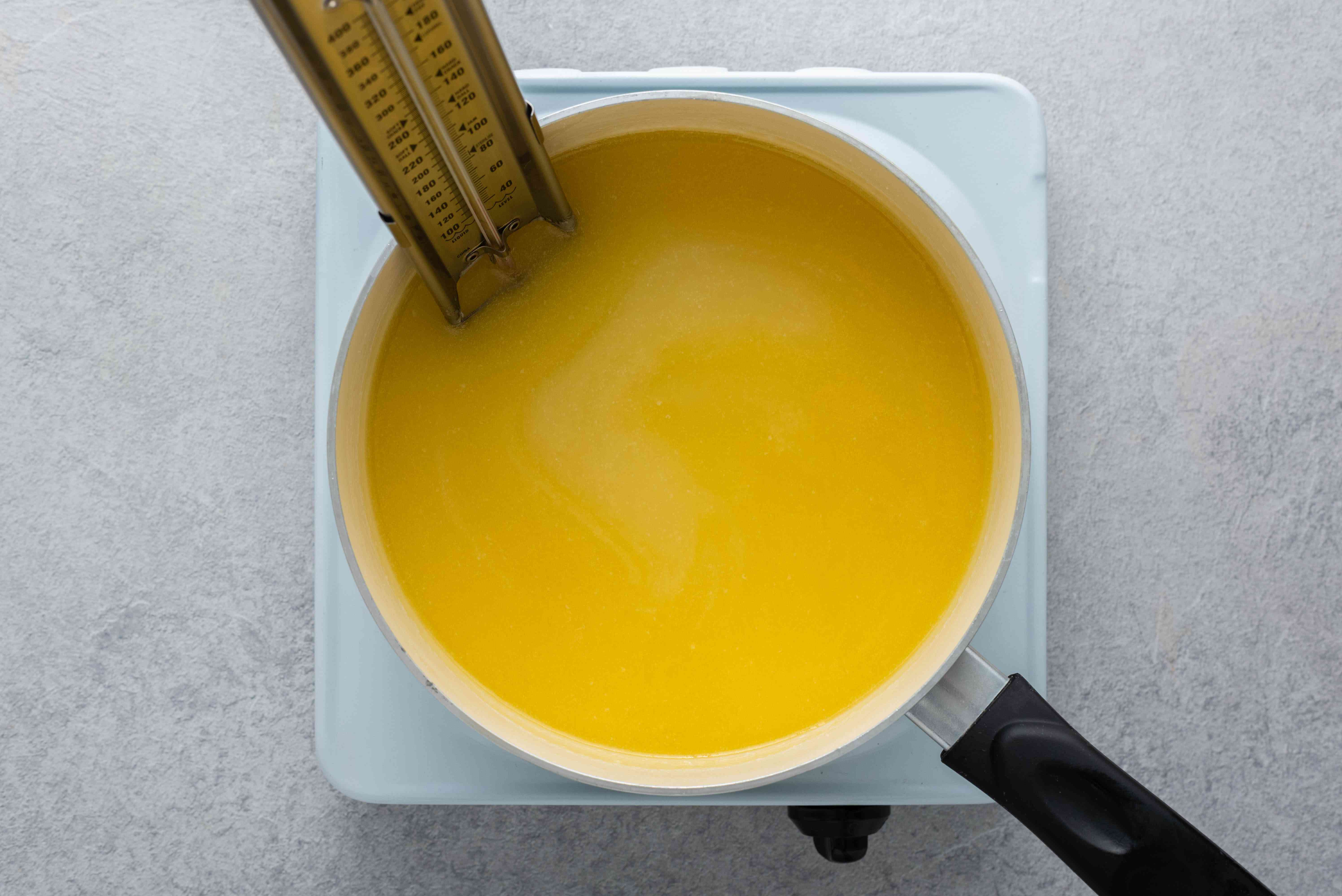 cooking fudge in a saucepan, candy thermometer