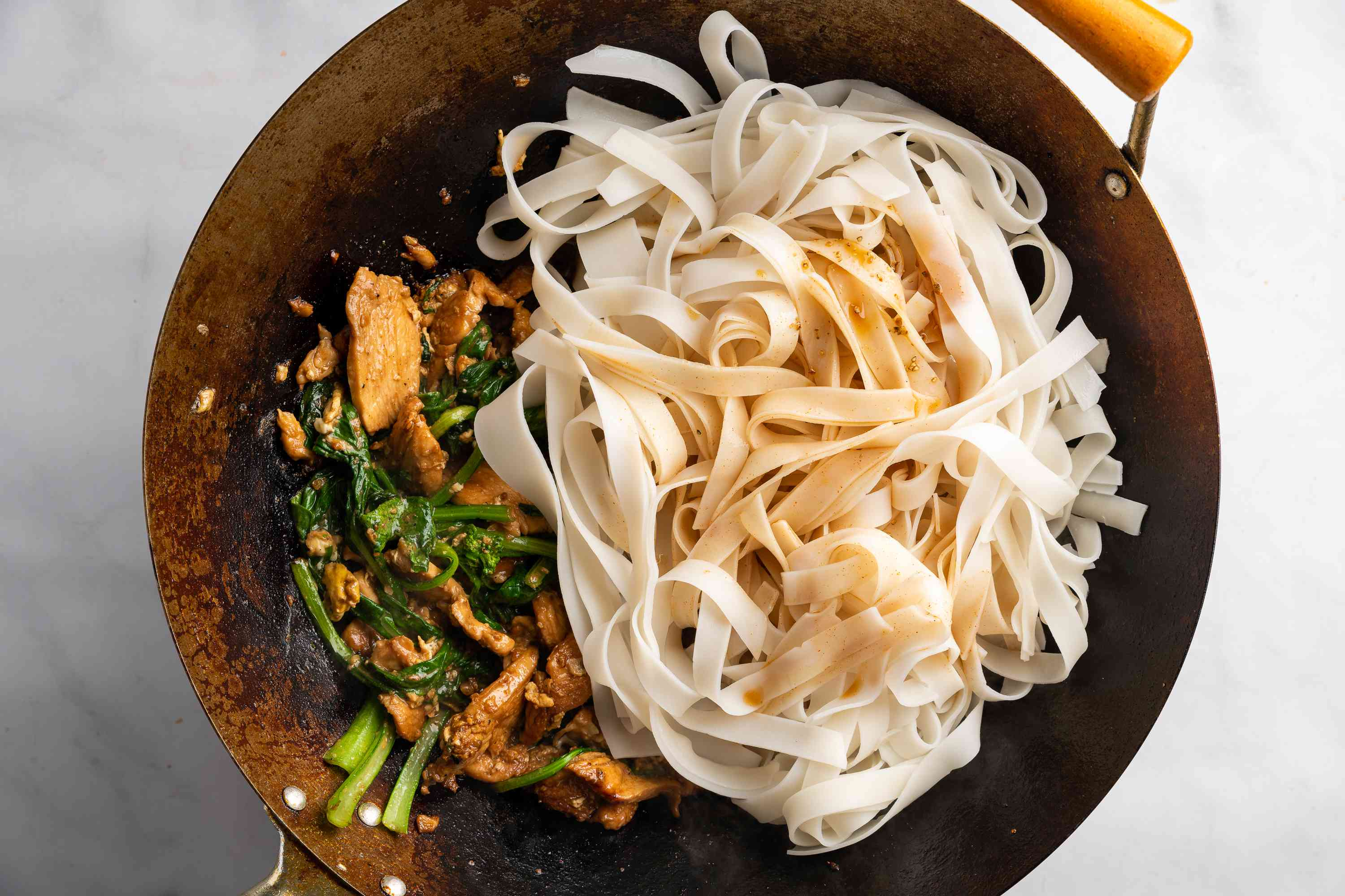 Add the noodles to the wok and pour the stir-fry sauce over the noodles