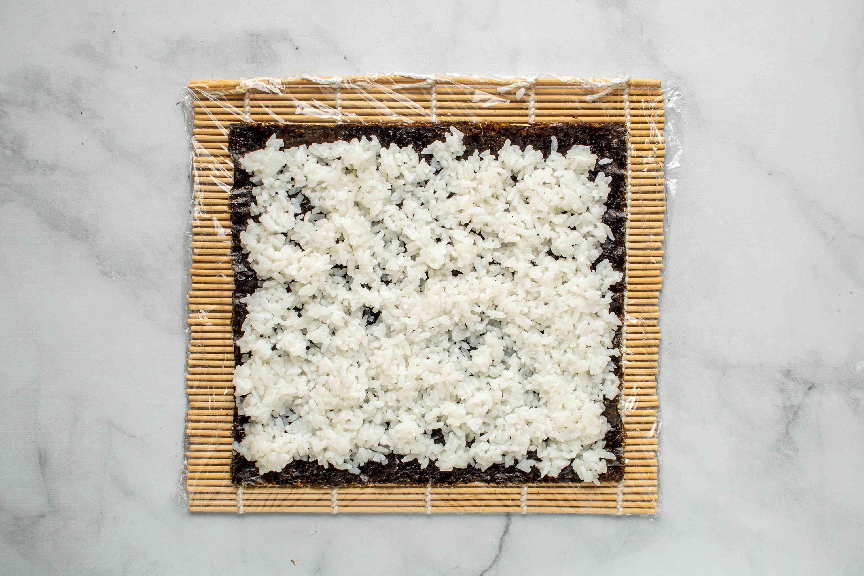 rice on top of seaweed sheet