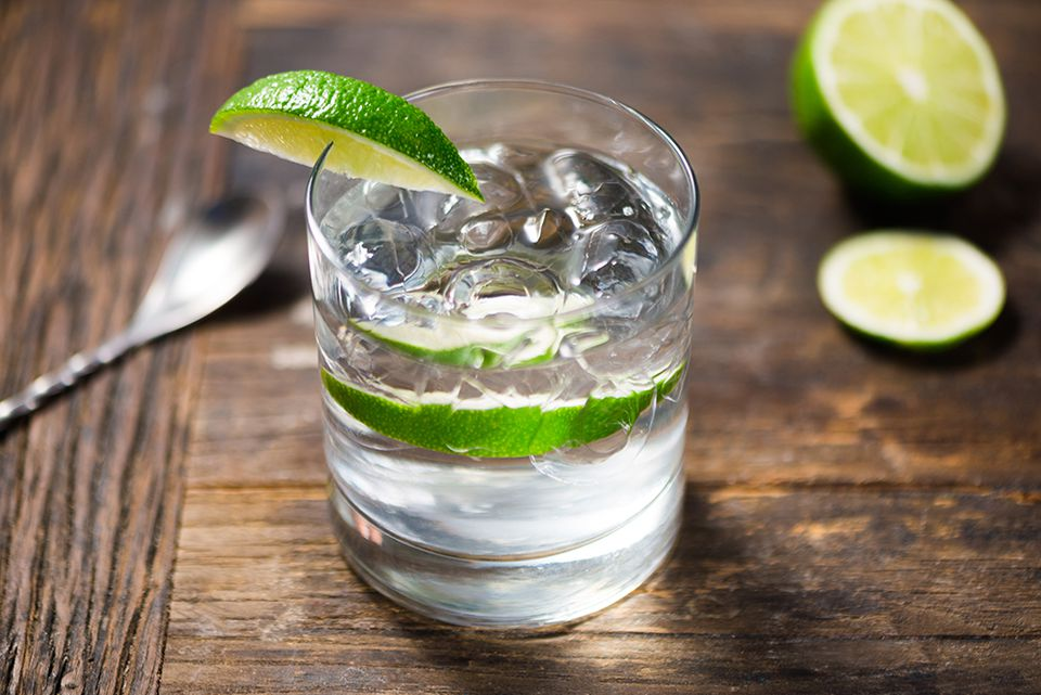 Gin and tonic garnished with fresh lime