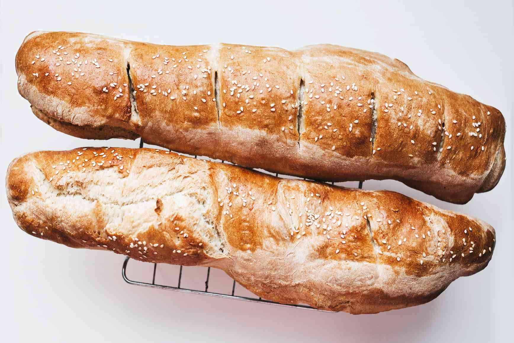 Baked French bread cooling on a wire rack