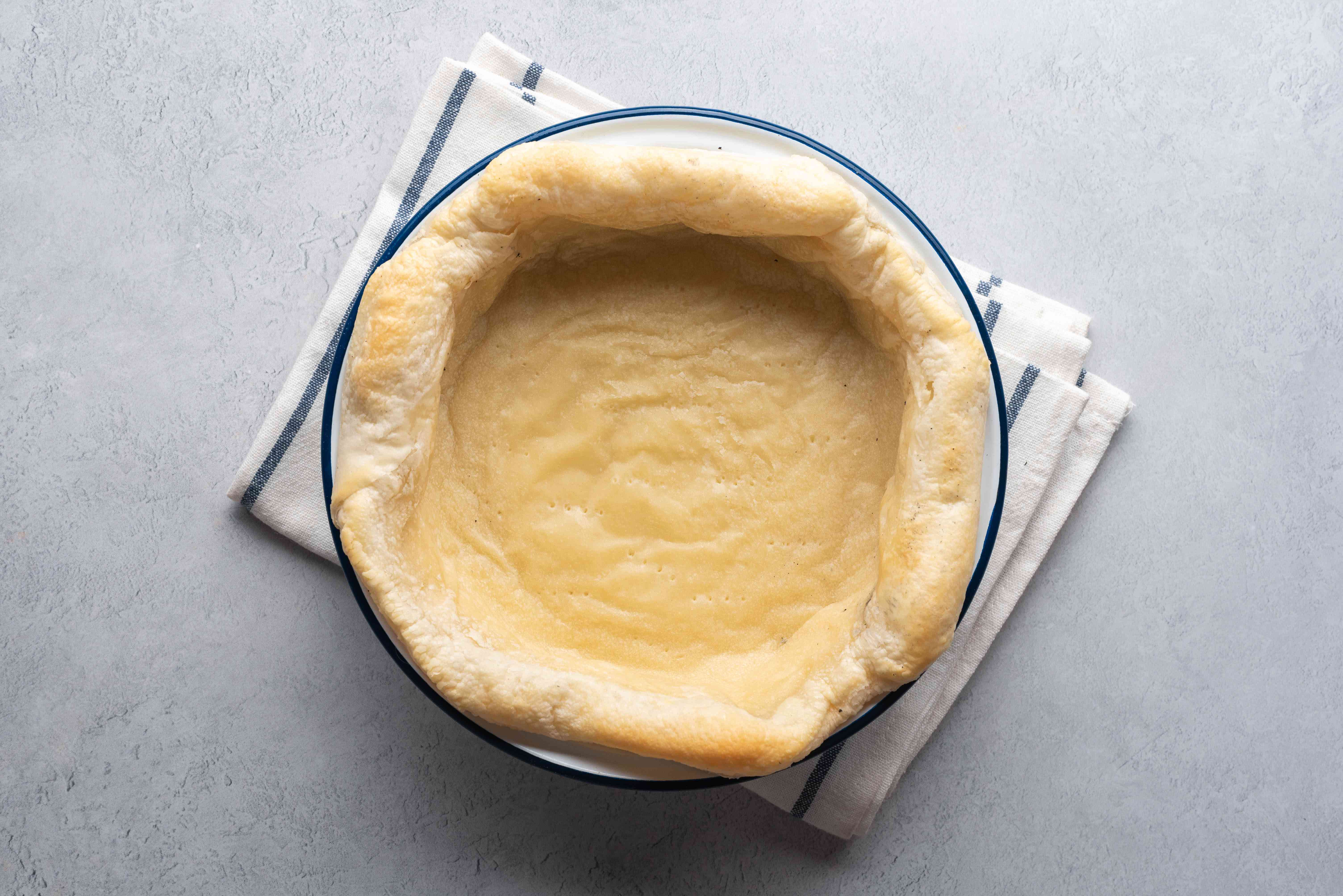 Remove the baking weights, and cook the dough further