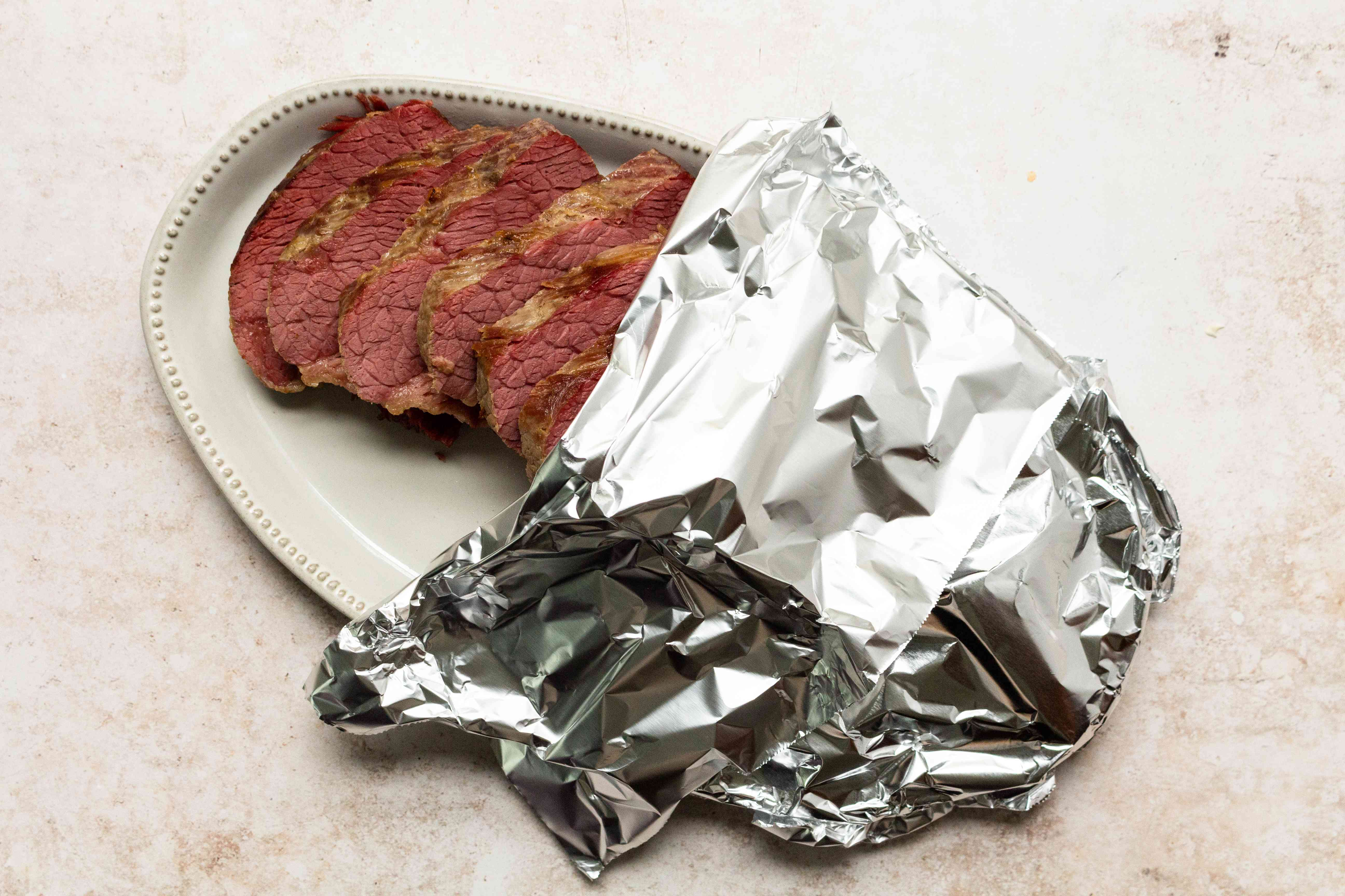 beef on a platter, with aluminum foil