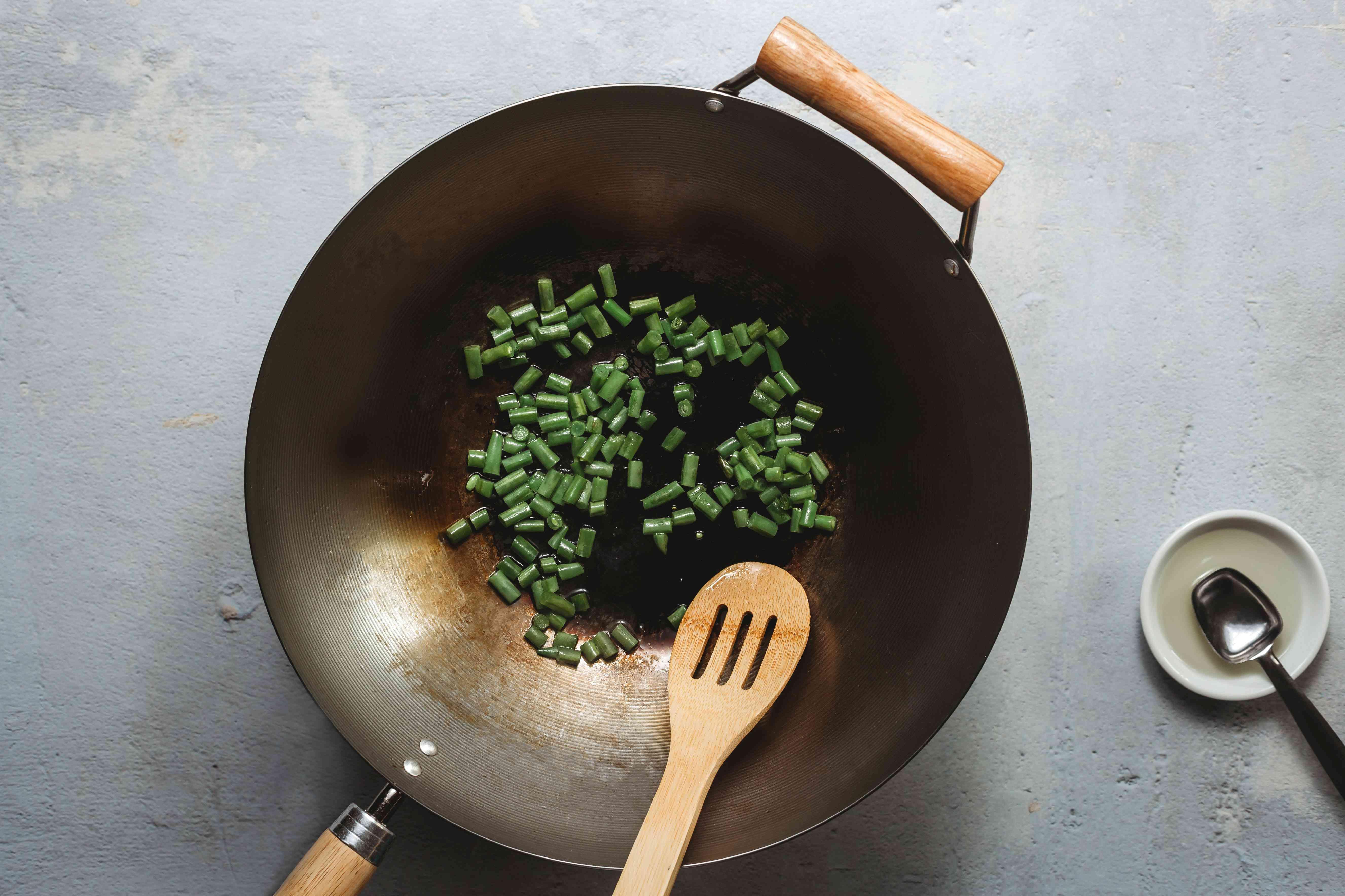 diced string beans in a wok