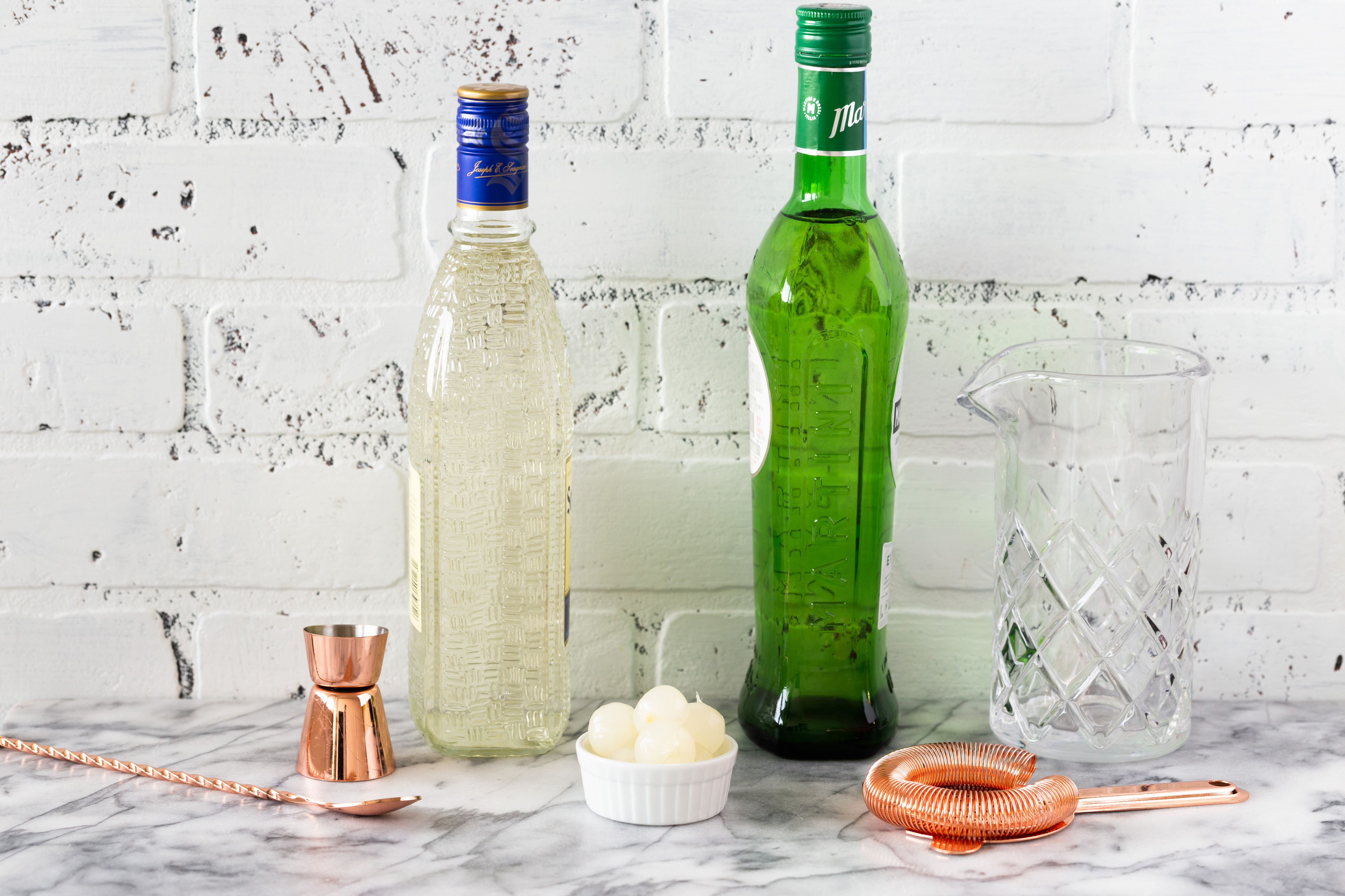 Ingredients for making a Gibson gin martini cocktail