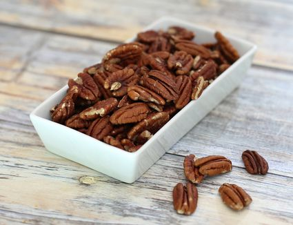 A small container of pecan halves
