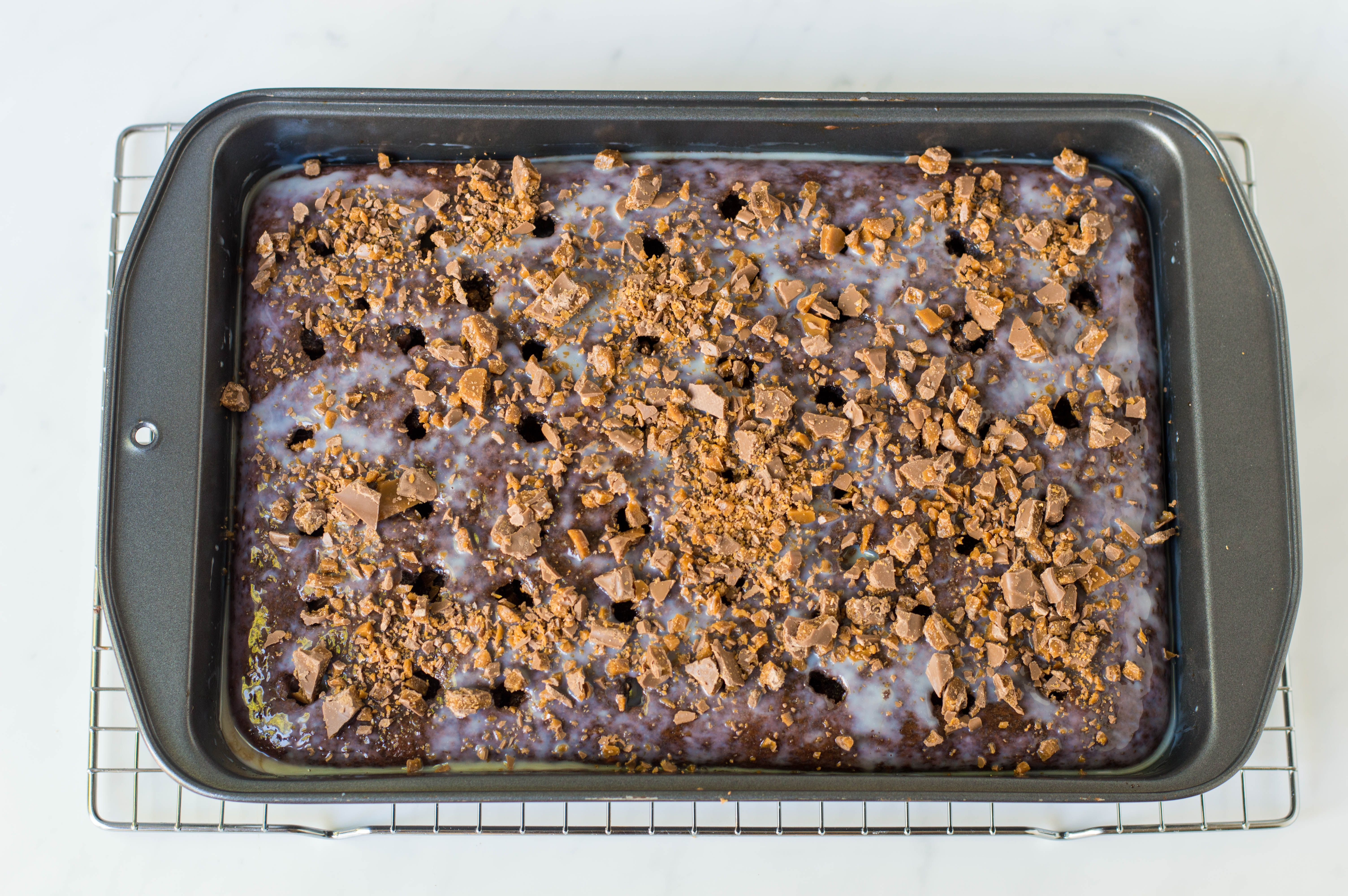 crumble candy bars on cake