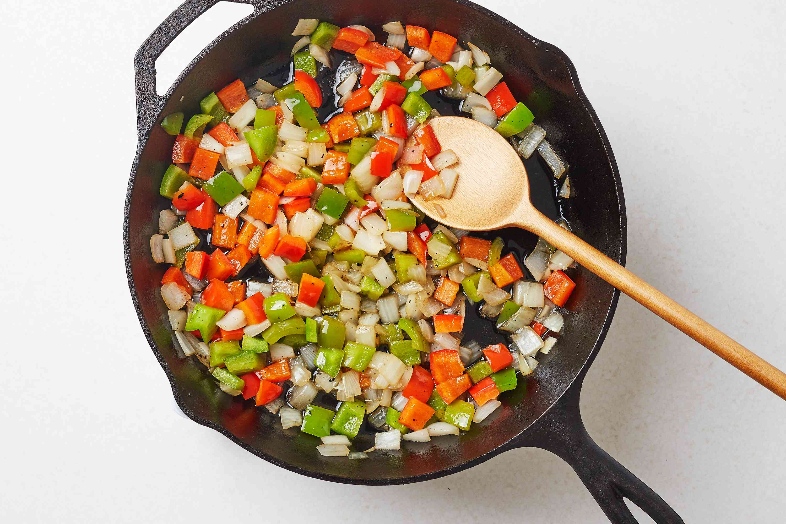 chopped onion and peppers in a pan