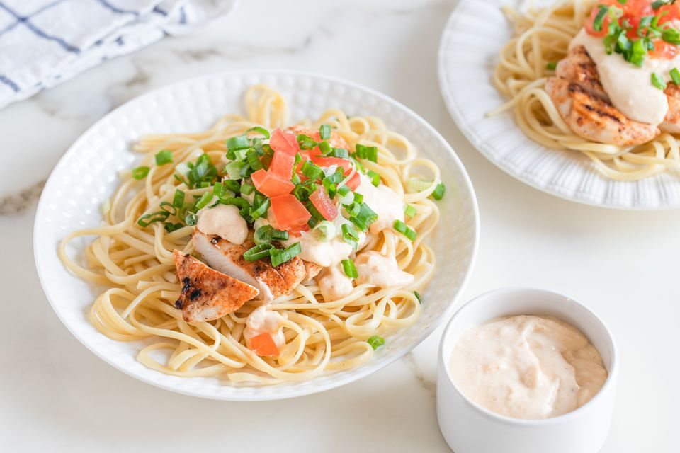 Grilled chicken with creamy Cajun sauce and linguine