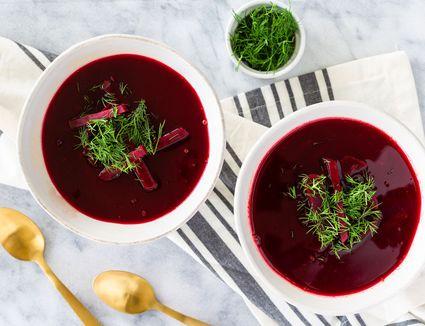 Polish beet soup in white bowls