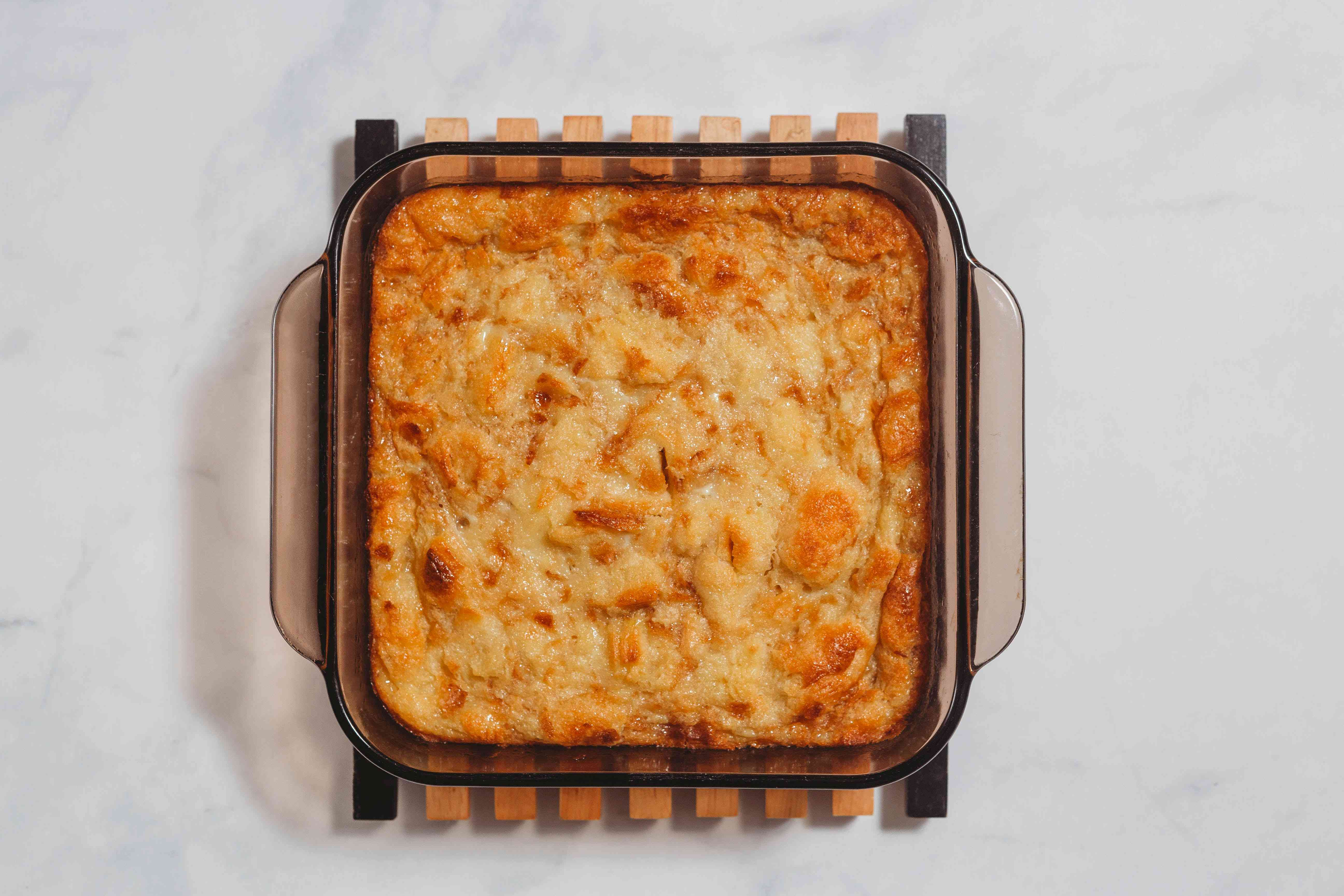 Baked Old-Fashioned Biscuit Pudding in a glass baking pan