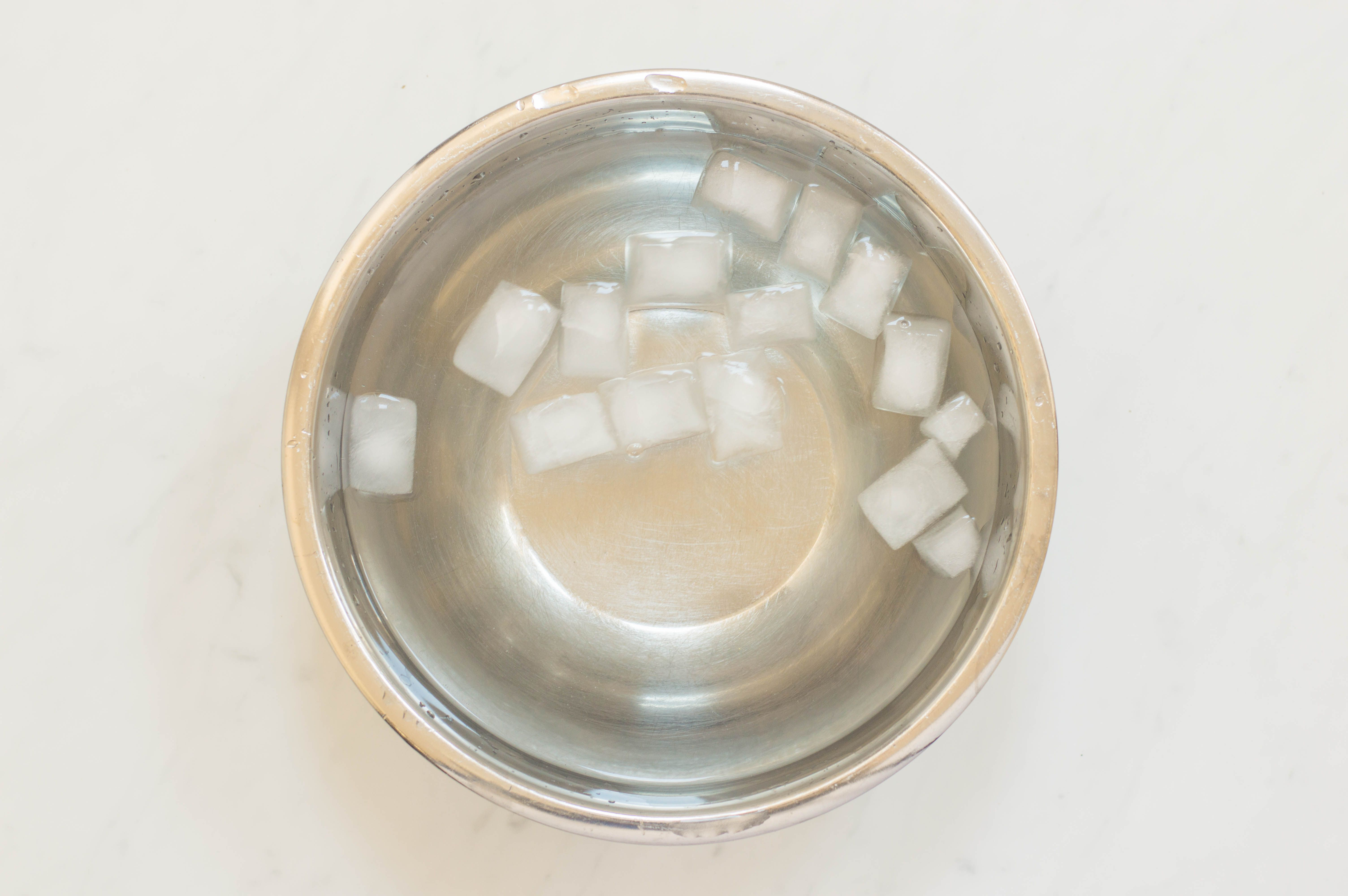 Fill a large bowl with ice