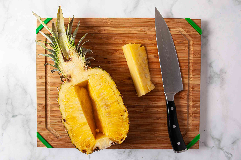 Cut around the edge of each pineapple half