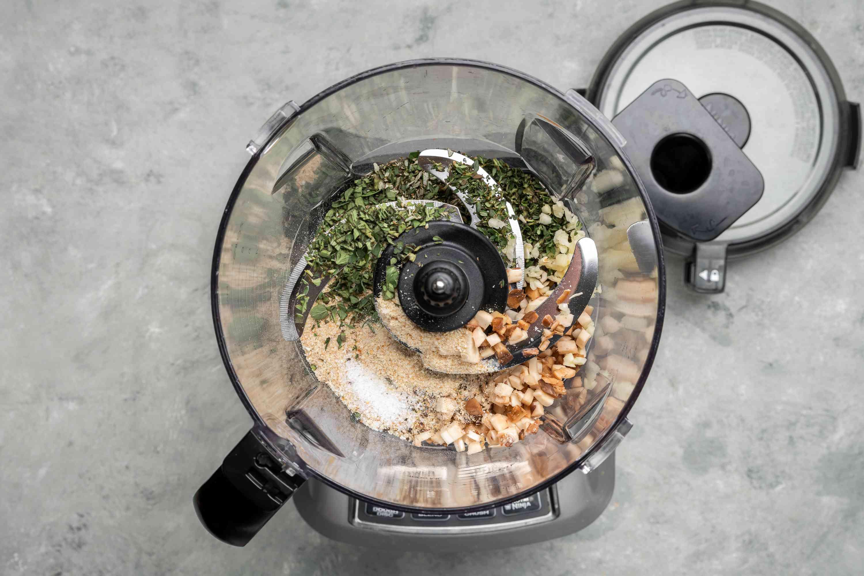 Breadcrumbs, mushroom stems, thyme, oregano, rosemary, garlic, salt, and pepper in a food processor