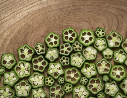 Okra slices on wood