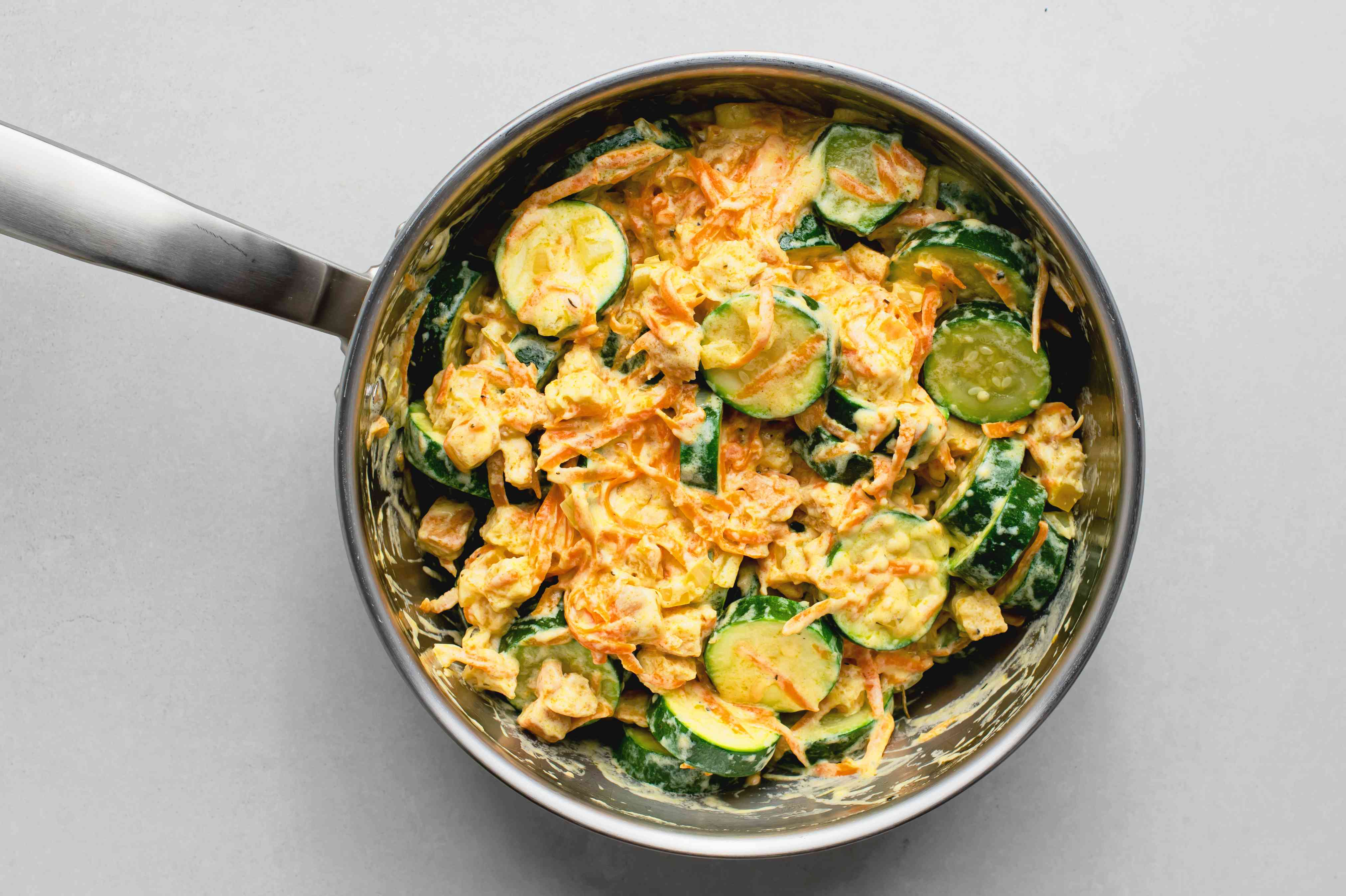 zucchini added to the stuffing mixture in the pan