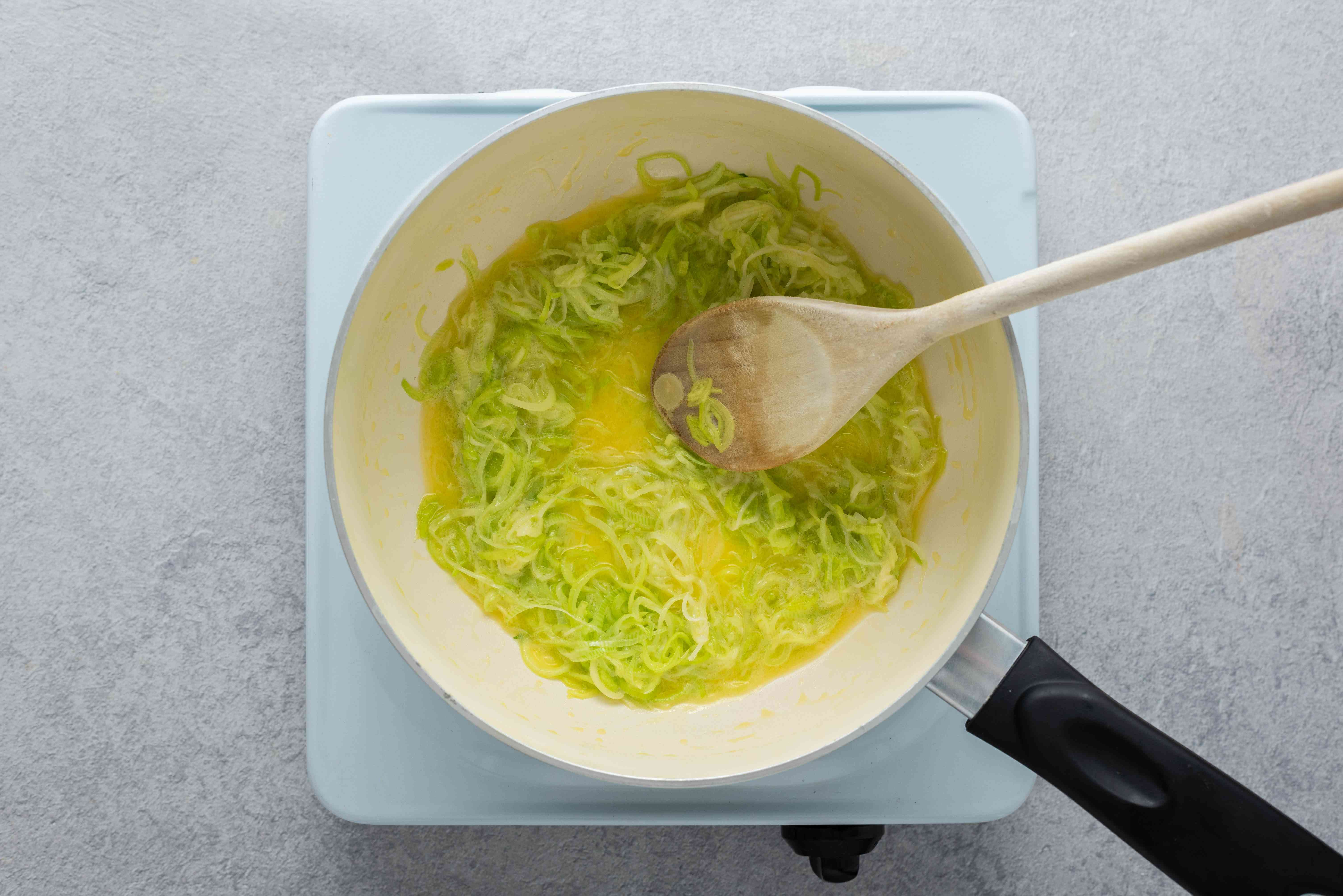 Leeks cooking with butter in a saucepan